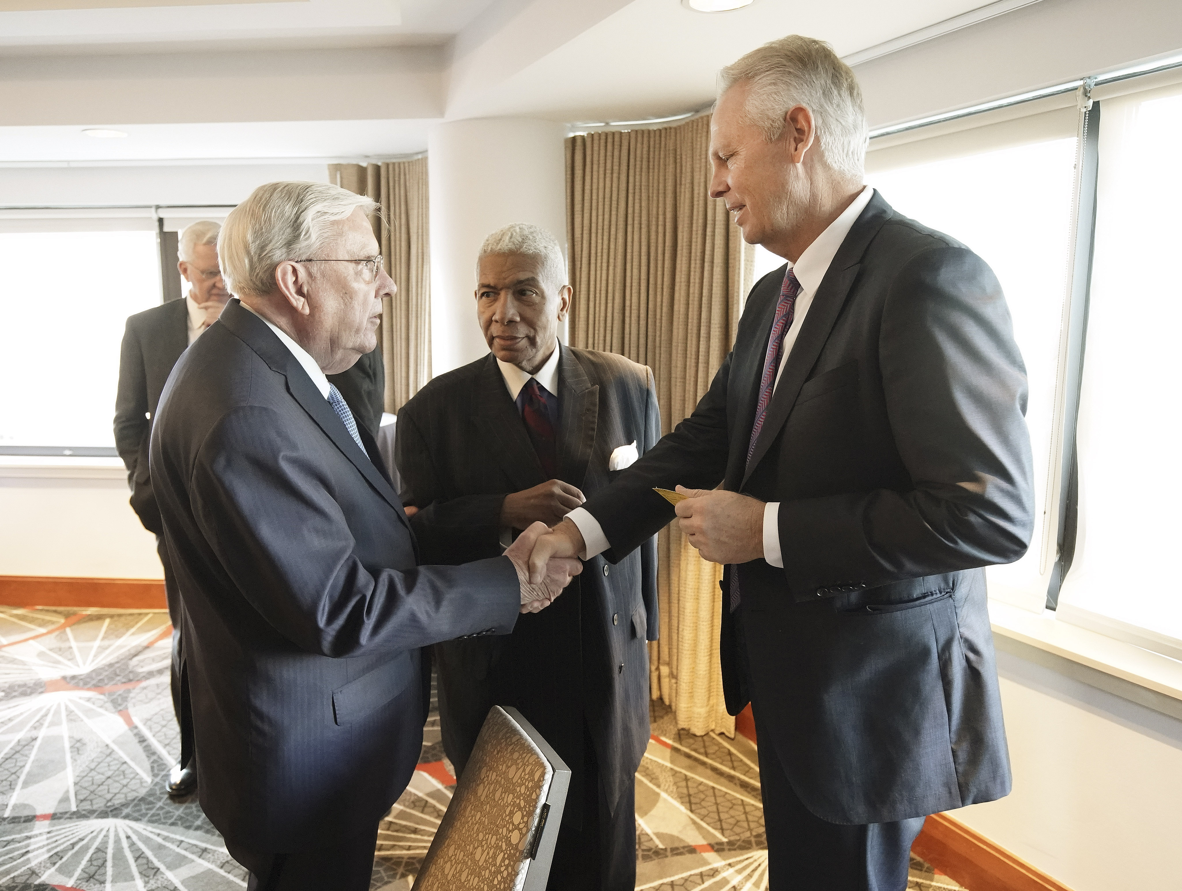 President M. Russell Ballard, acting president of the Quorum of the Twelve Apostles of The Church of Jesus Christ of Latter-day Saints, meets with Danny Ainge, general manager and President of Basketball Operations for the Boston Celtics, and the Rev. Eugene Rivers in Boston on Saturday, Oct. 19, 2019.