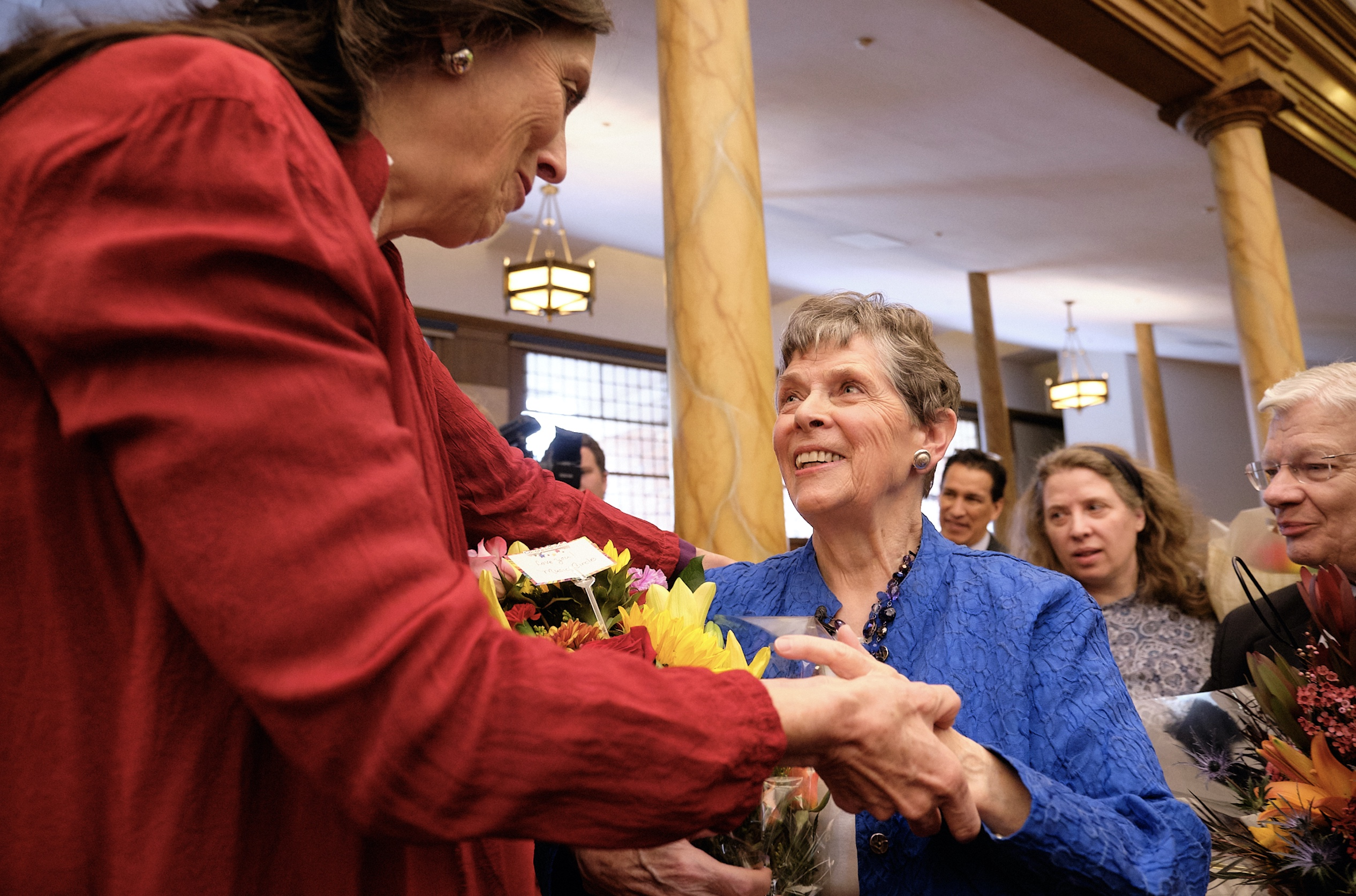 Retiring Temple Square organist Bonnie Goodliffe accepts flowers and hugs from family and friends at the Salt Lake Tabernacle on Monday, Oct. 21, 2019.