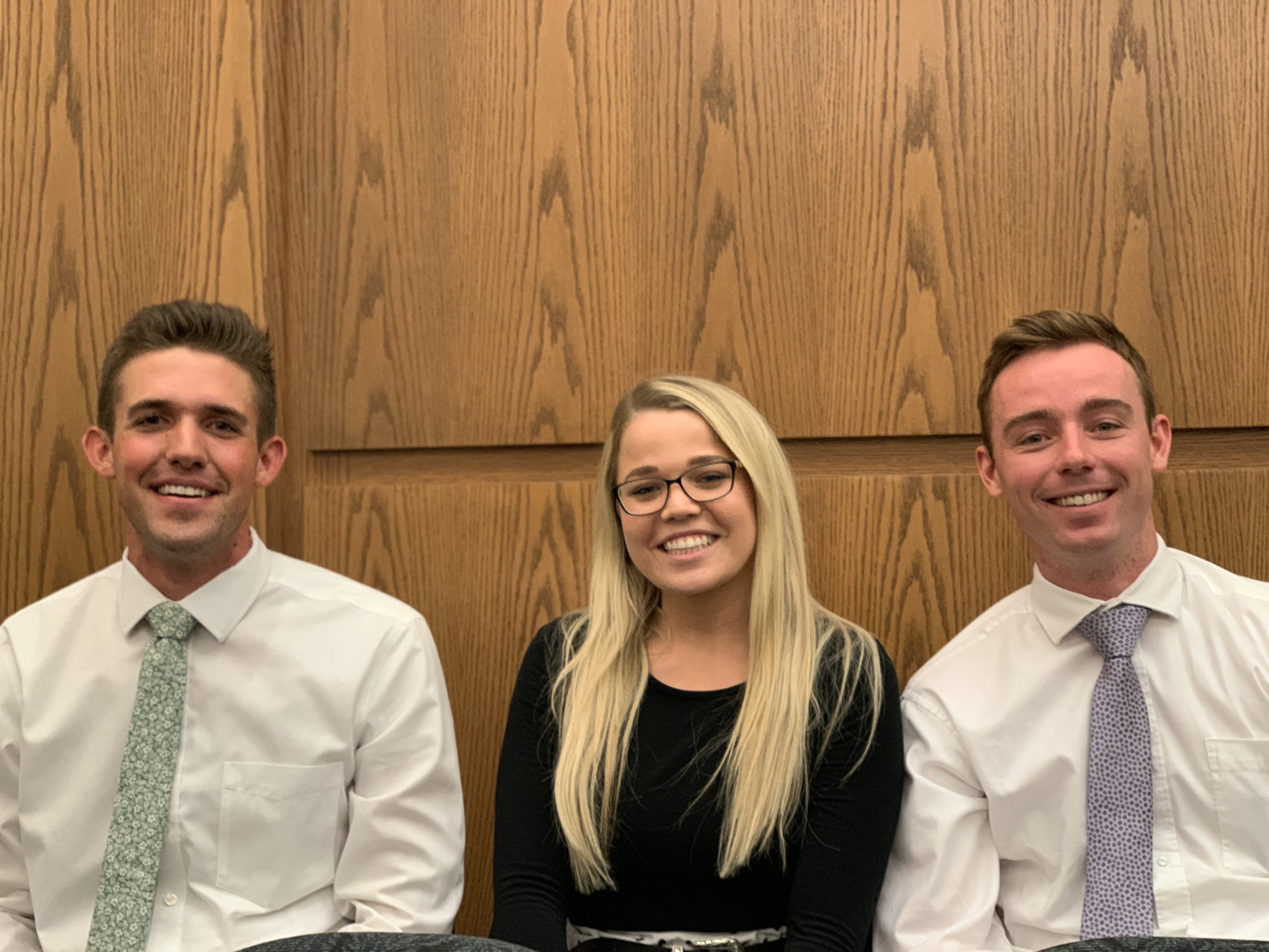 From left, Dallan Larson, Reilly Ward and Matt Anderson attend a devotional by Elder Ronald A. Rasband at the Tempe Arizona Institute of Religion on Oct. 20.