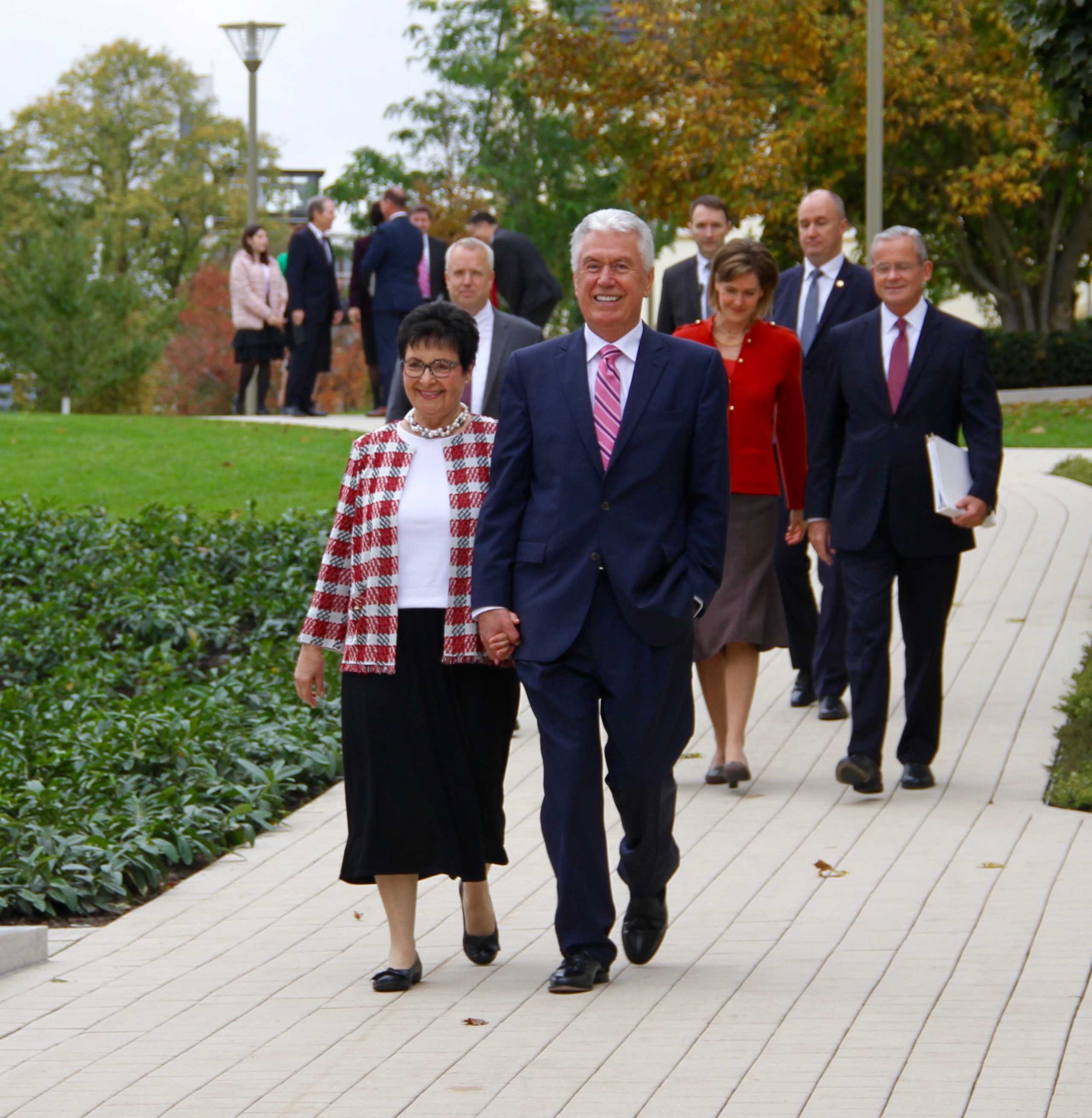 Elder Dieter F. Uchtdorf and Sister Harriet Uchtdorf lead an arriving group of Church leaders and spouses at the Frankfurt Germany Temple on Saturday, Oct. 19, 2019.