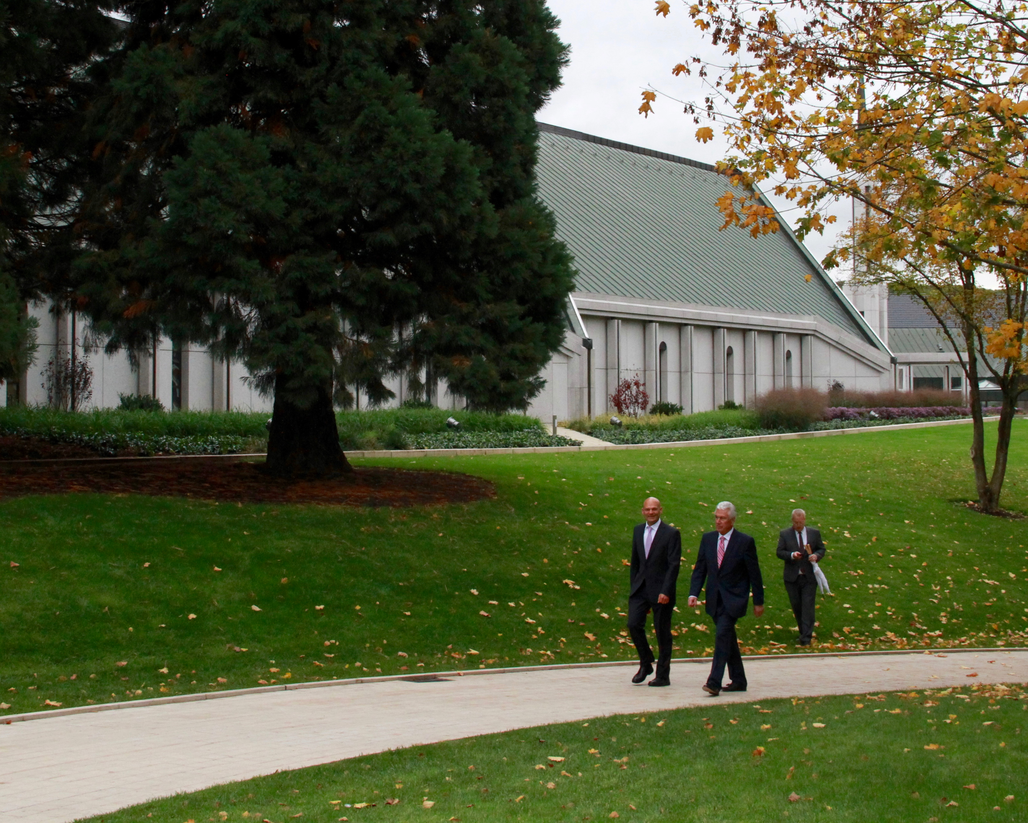 Elder Dieter F. Uchtdorf, right, and his son, Guido Uchtdorf, recreate a walk past the Frankfurt temple on Oct. 19, 2019, and on to the city center of Friedrichsdorf, Germany, in honor of a similar walk with three apostles during the temple's 1987 dedication.