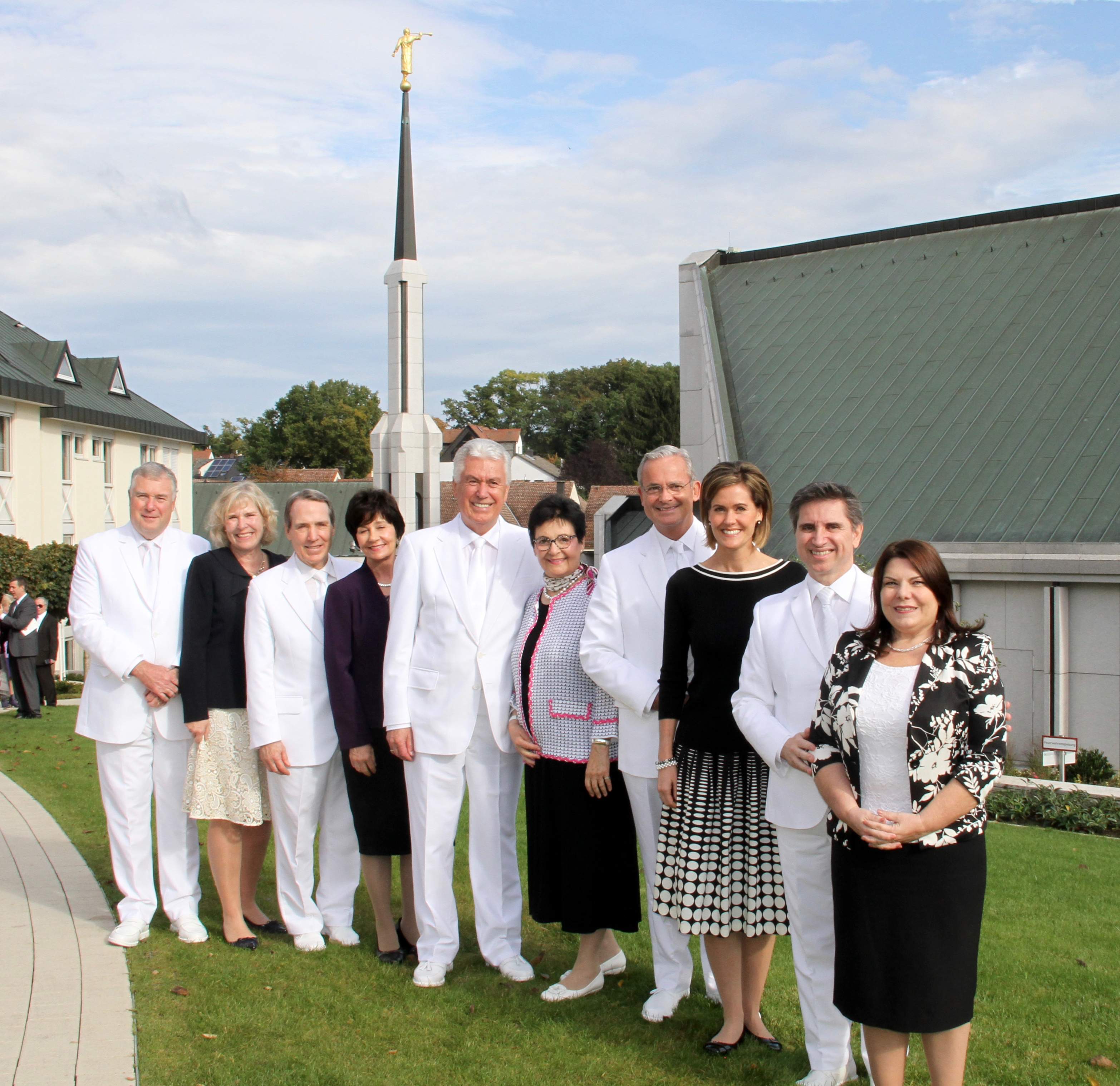 From left: Elder Erich W. Koplischke, Sister Christiane Kopischke, Elder Gary B. Sabin, Sister Valerie Sabin, Elder Dieter F. Uchtdorf, Sister Harriet Uchtdorf, Elder Patrick Kearon, Sister Jennifer Kearon, Elder Massimo De Feo and Sister Loredana De Feo gather for a group photo outside the Frankfurt Germany Temple between rededication sessions on Oct. 20, 2019.