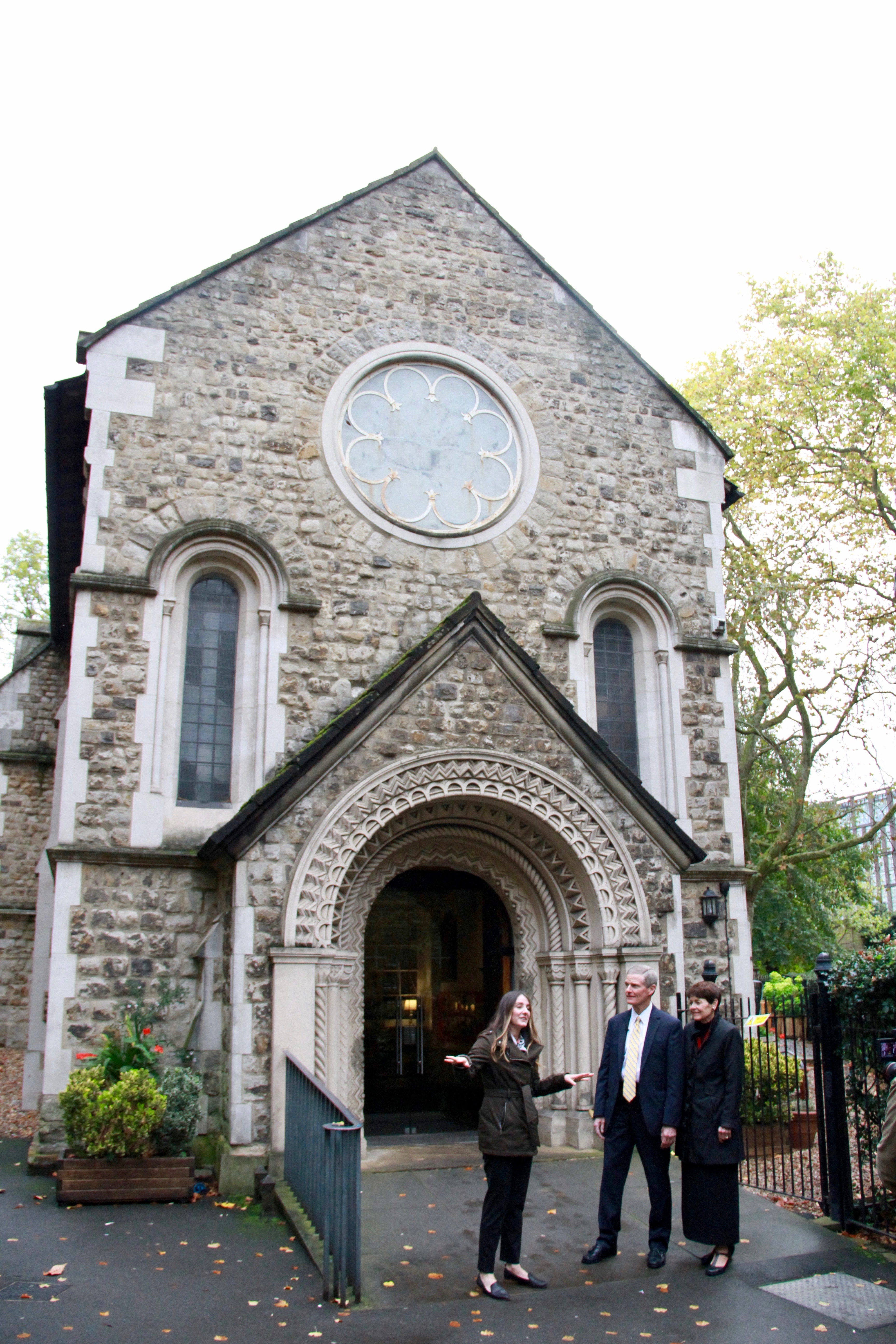 Whitney Peterson, a FamilySearch content strategist specializing in the British Isles, gives historical background for the St. Pancras Old Church to Elder David A. Bednar and his wife, Sister Susan Bednar, on Oct. 25, 2019, in London.