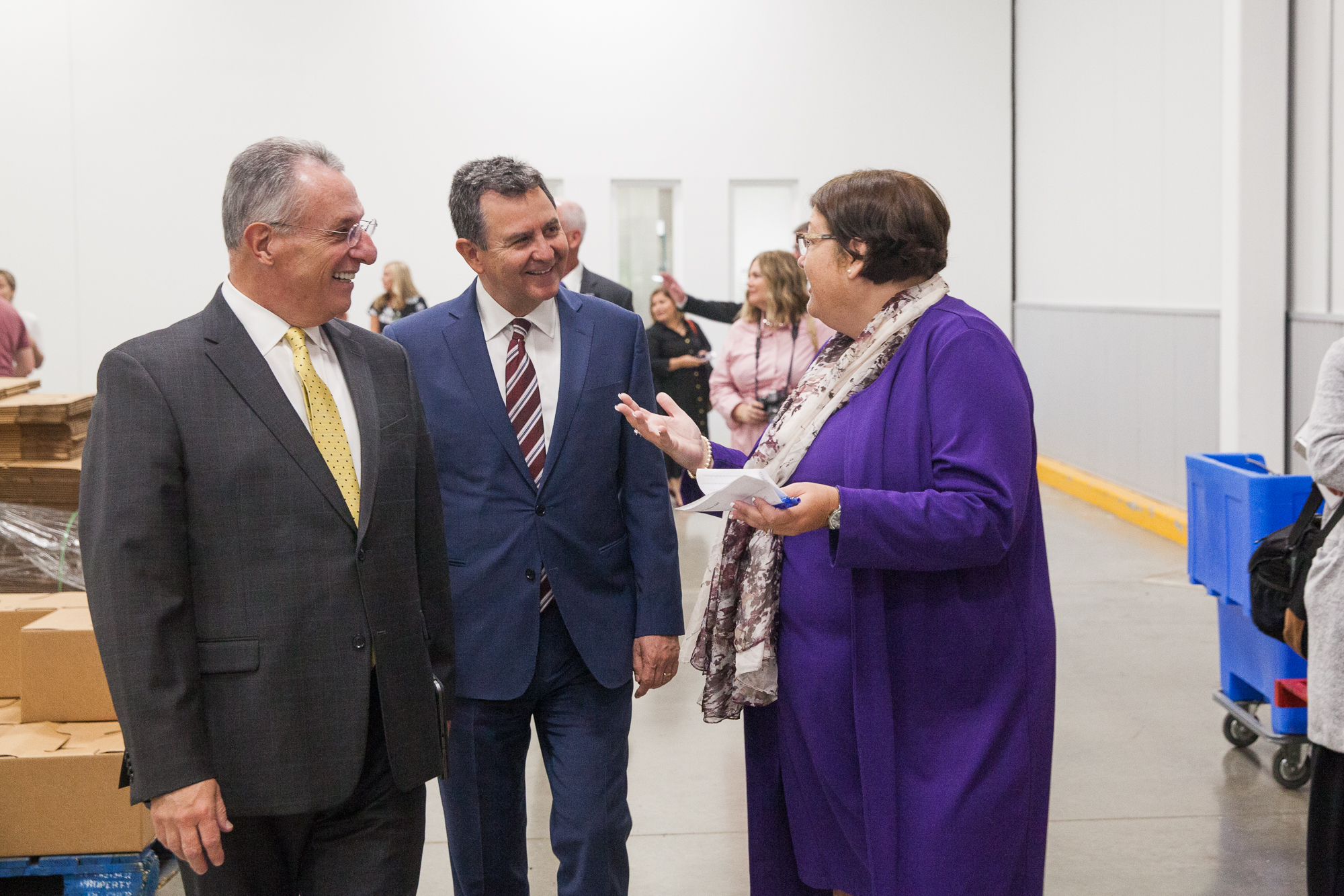 Elder Ulisses Soares, left, and Elder Adrian Ochoa speak with Denise Blok, chief operating officer of the Central Texas Food Bank during a visit to their facilities on Oct. 18, 2019.