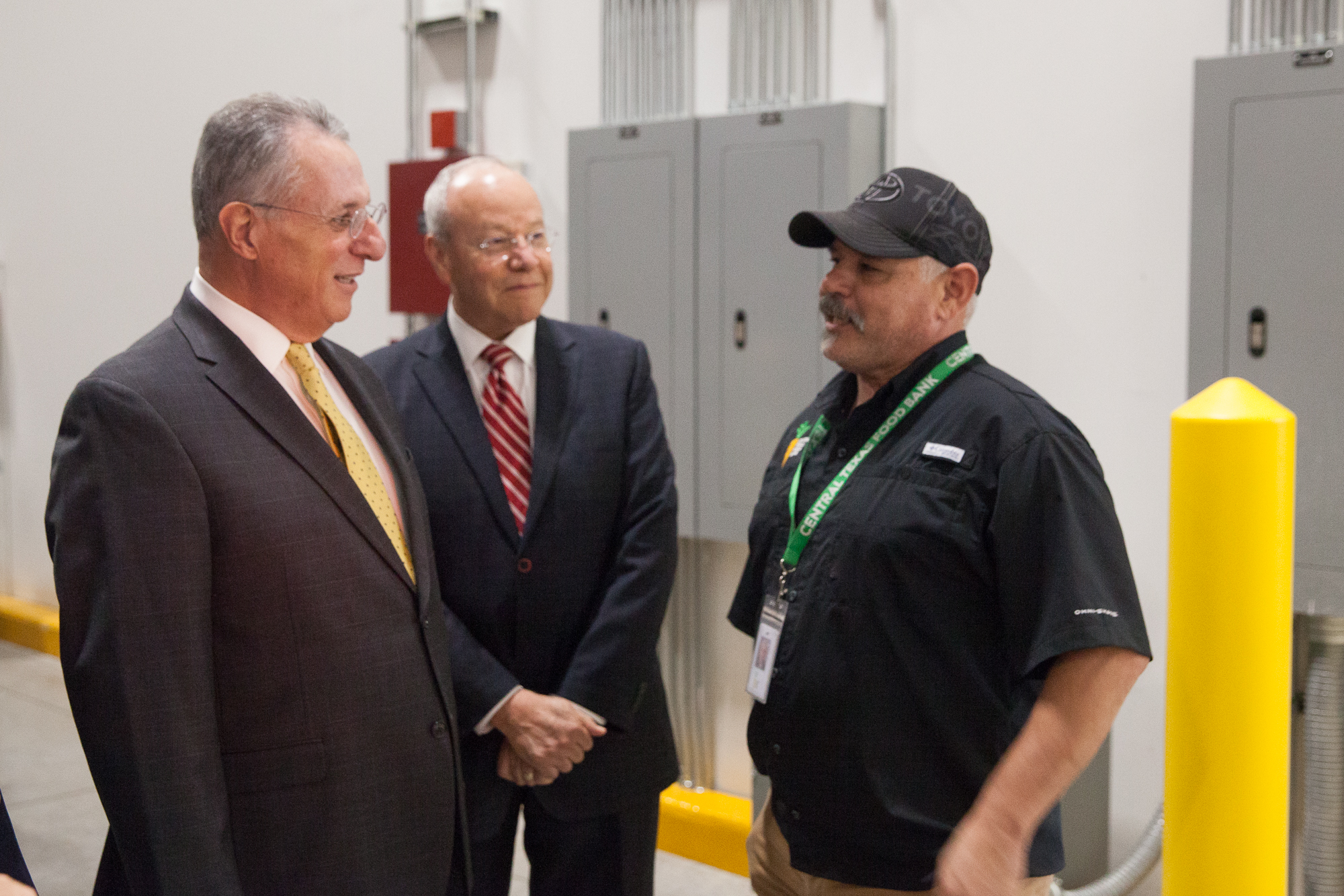 Elder Ulisses Soares speaks with an employee of the Central Texas Food Bank during a visit on Oct. 18, 2019.