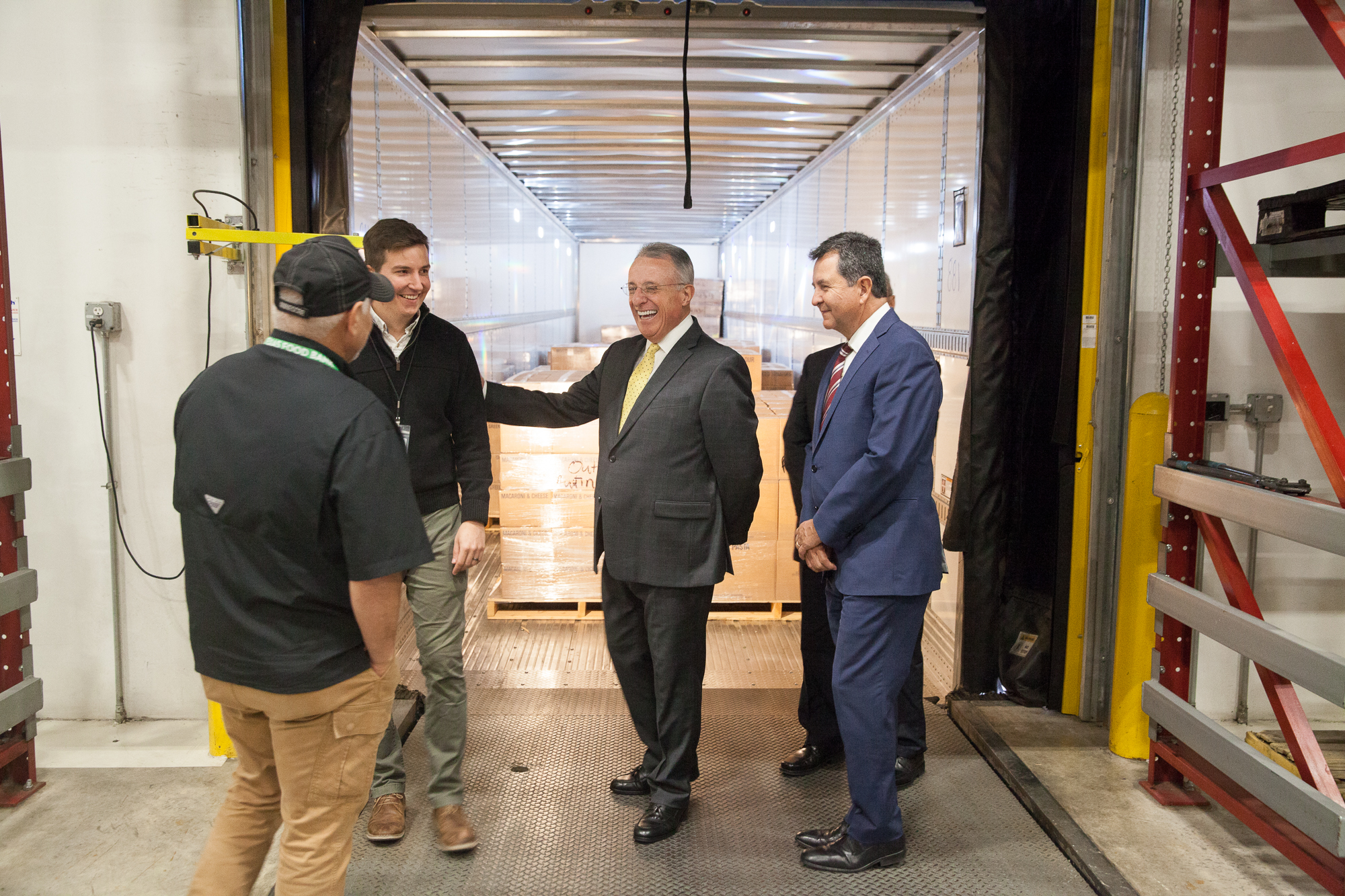 Elder Ulisses Soares talks with employees at the Central Texas Food Bank during a visit on Oct. 18, 2019. The Church donated 41,000 pounds of dry food products to the food bank.
