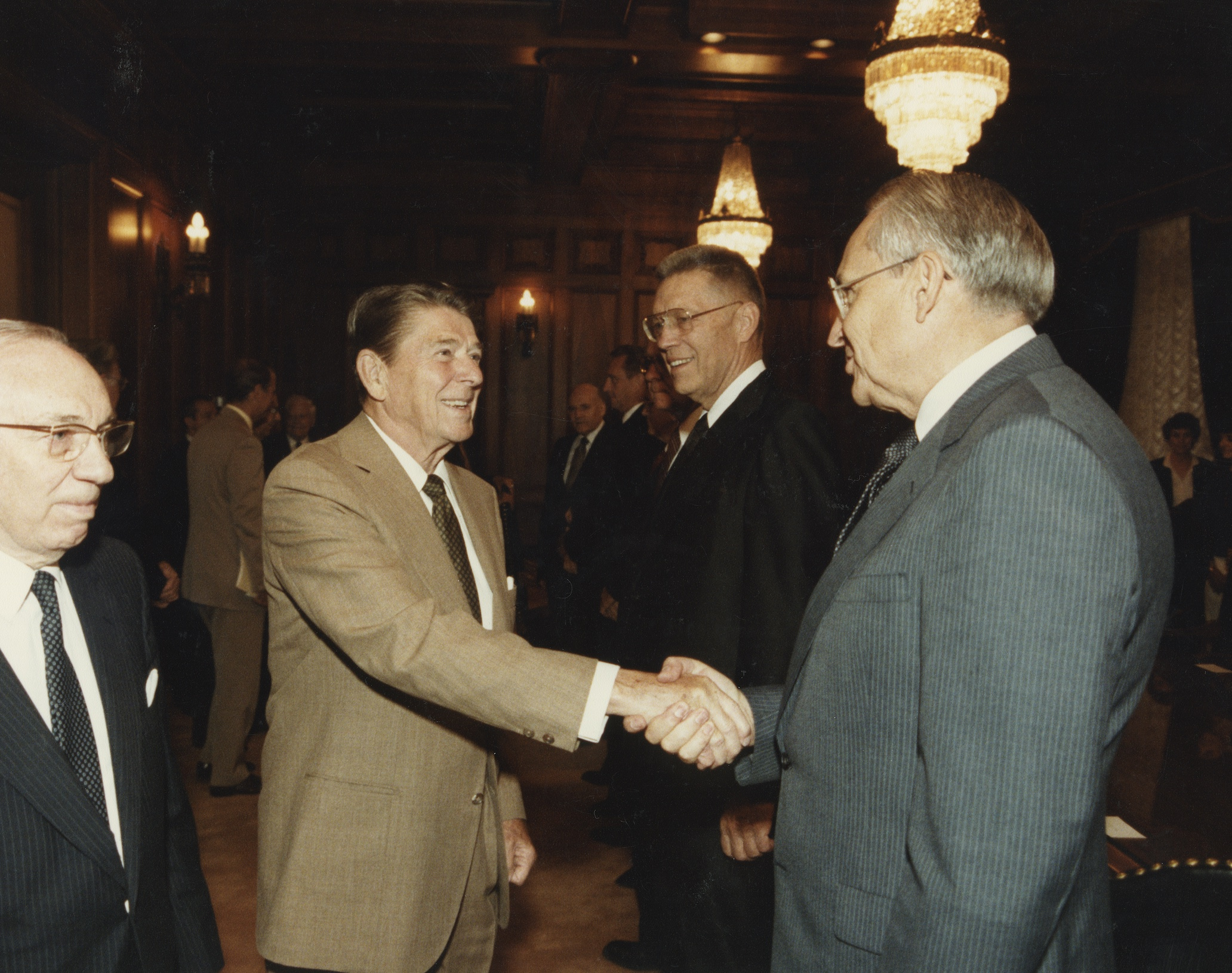 Elder L. Tom Perry shakes hands with U.S. President Ronald Reagan in Sept. 1984. Also seen are President Gordon B. Hinckley, left, and Elder Bruce R. McConkie, middle.