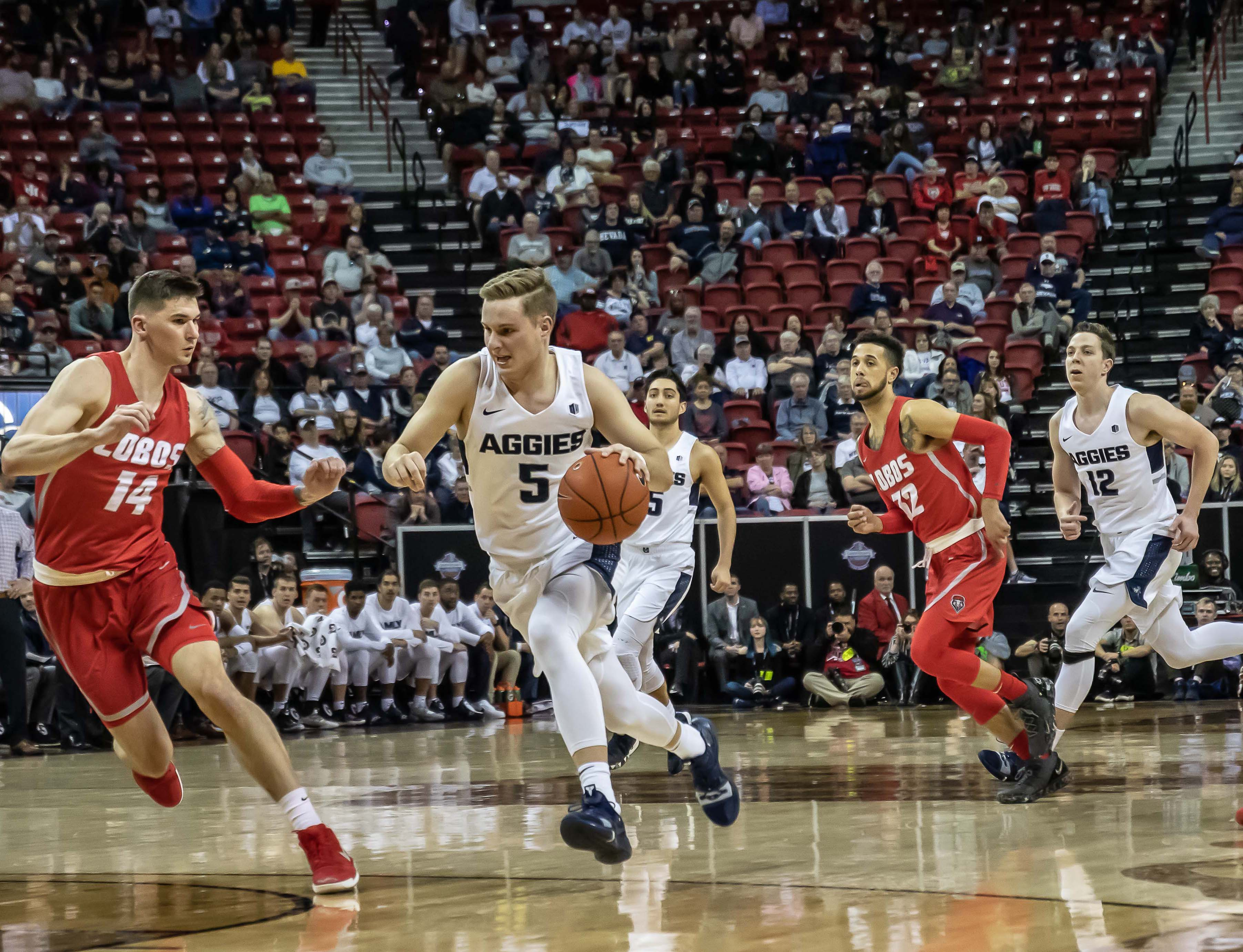 Returned missionary Sam Merrill drives with the ball during game between Merrill's Utah State Aggies and the New Mexico Lobos.