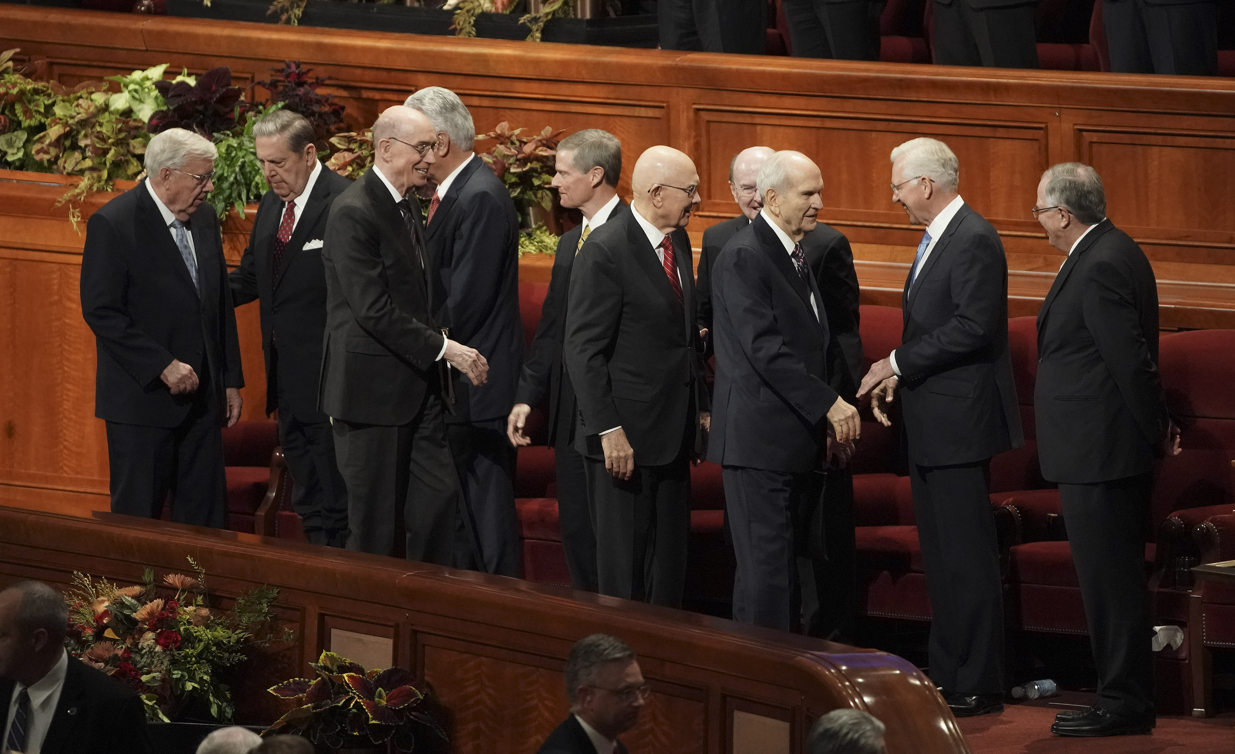 President Russell M. Nelson of The Church of Jesus Christ of Latter-day Saints, and his counselors, President Dallin H. Oaks, first counselor in the First Presidency, and President Henry B. Eyring, second counselor in the First Presidency, shakes hands after the Saturday morning session of the faith's 189th Semiannual General Conference in the Conference Center in Salt Lake City on Saturday, Oct. 5, 2019.