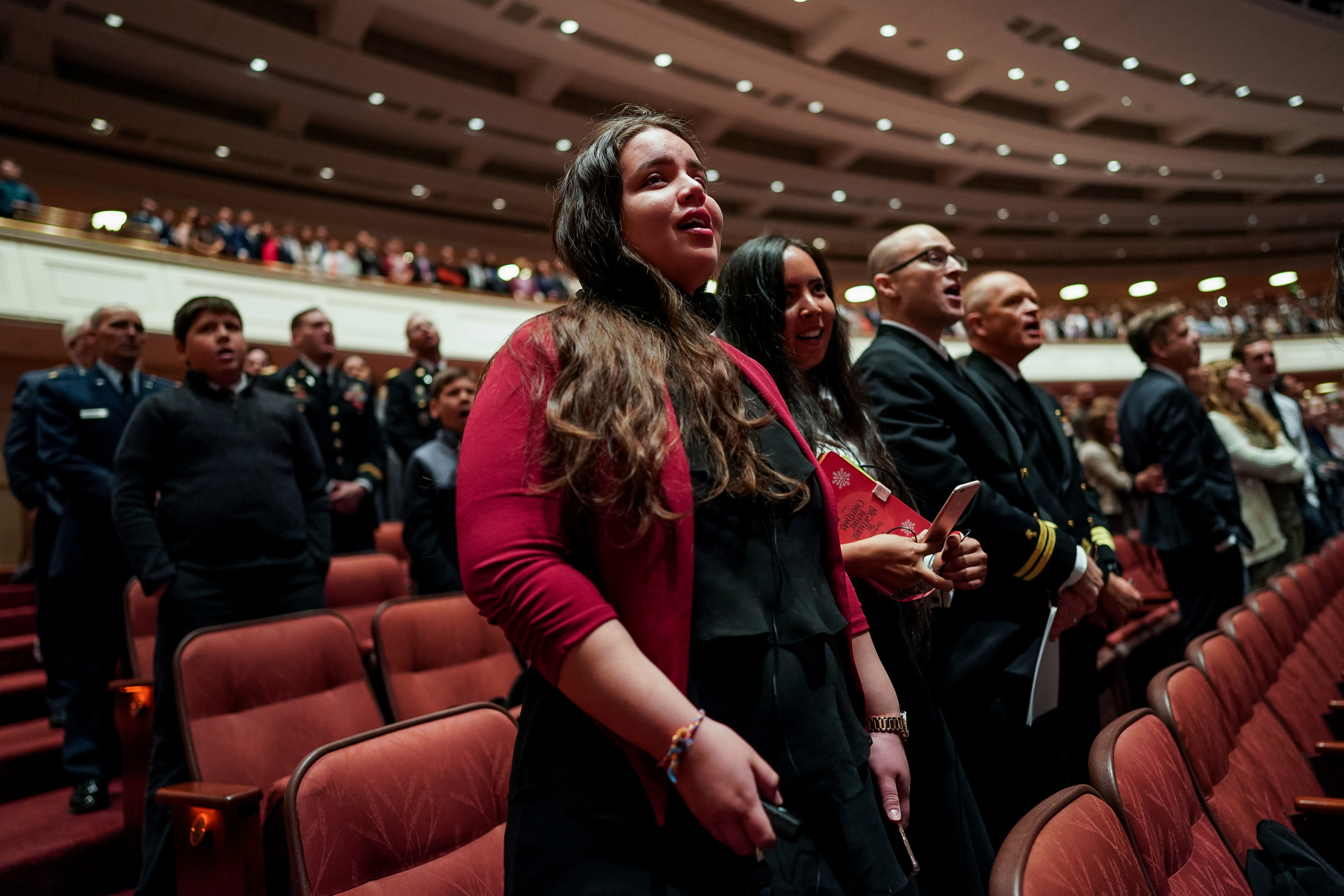 Conferencegoers sing along with the Tabernacle Choir at Temple Square during the Saturday morning session of the 189th Semiannual General Conference of The Church of Jesus Christ of Latter-day Saints at the Conference Center in Salt Lake City on Saturday, Oct. 5, 2019.