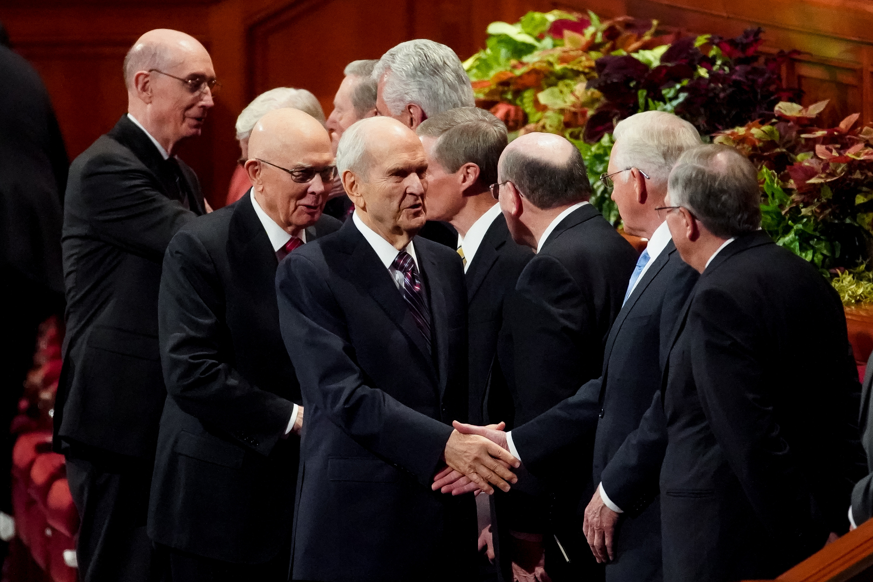 President Russell M. Nelson, third from left, President Dallin H. Oaks, first counselor in the First Presidency, second from left, and President Henry B. Eyring, second counselor in the First Presidency, left, shake hands with members of the Quorum of the Twelve Apostles at the conclusion of the Saturday morning session of the 189th Semiannual General Conference of The Church of Jesus Christ of Latter-day Saints in the Conference Center in Salt Lake City on Saturday, Oct. 5, 2019.