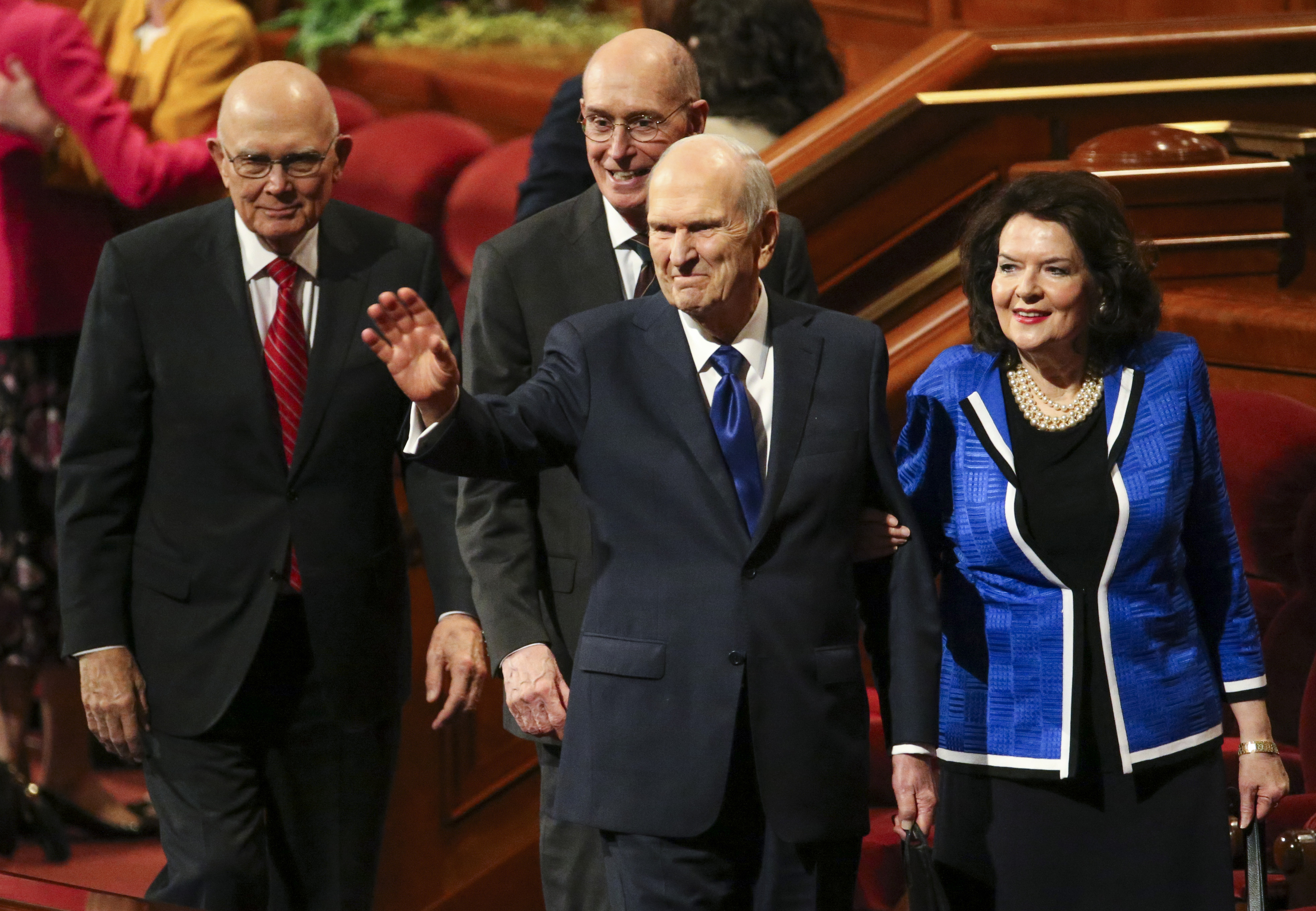 President Russell M. Nelson, center, waves at the crowd following the women's session of the 189th Semiannual General Conference of The Church of Jesus Christ of Latter-day Saints at the Conference Center in Salt Lake City on Saturday, Oct. 5, 2019. Behind him are President Dallin H. Oaks, first counselor in the First Presidency, left, and President Henry B. Eyring, second counselor in the First Presidency, and on the right is Sister Wendy Nelson, President Nelson's wife.