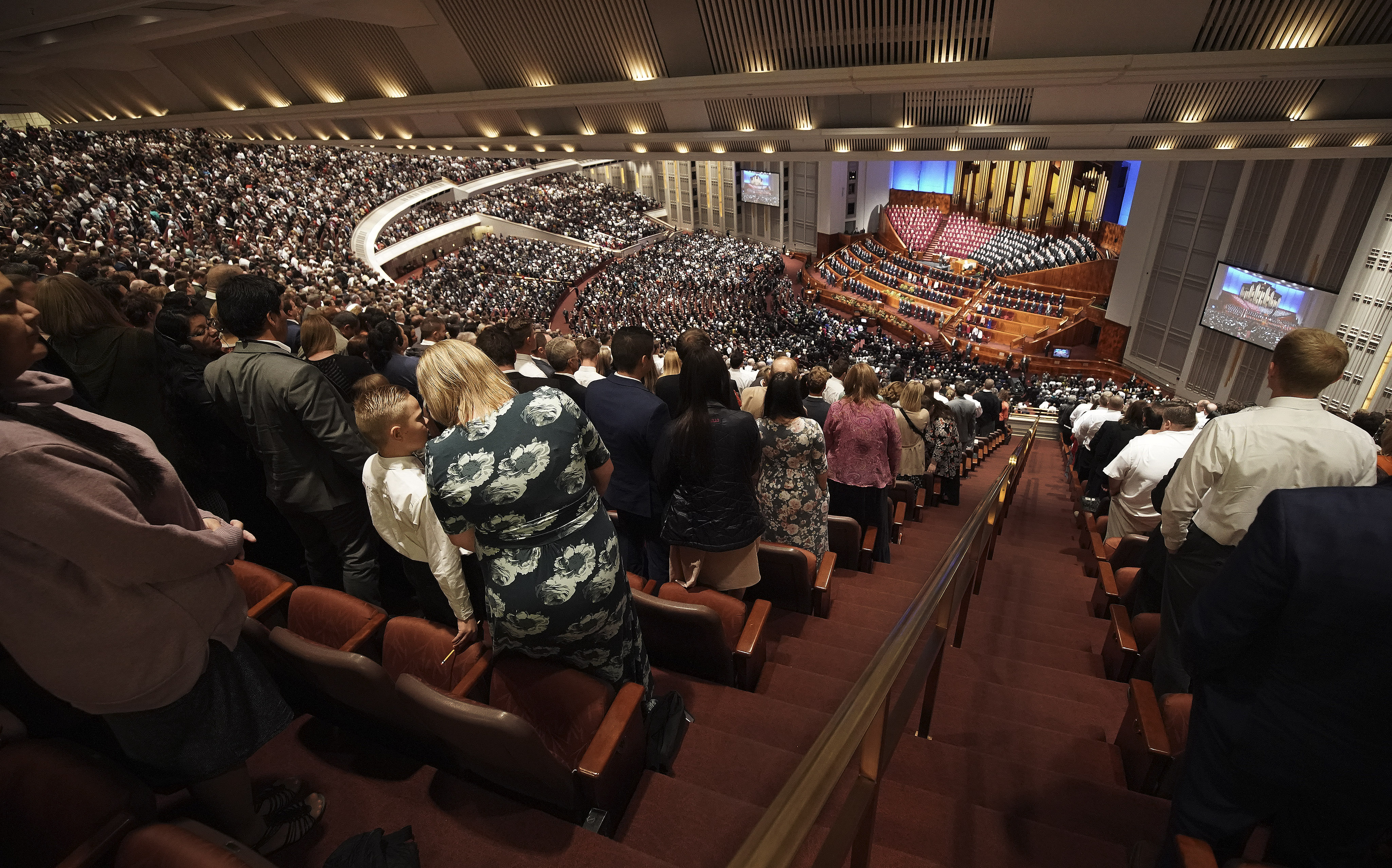 Conferencegoers sing during the Sunday morning session of the 189th Semiannual General Conference of The Church of Jesus Christ of Latter-day Saints in Salt Lake City on Sunday, Oct. 6, 2019.