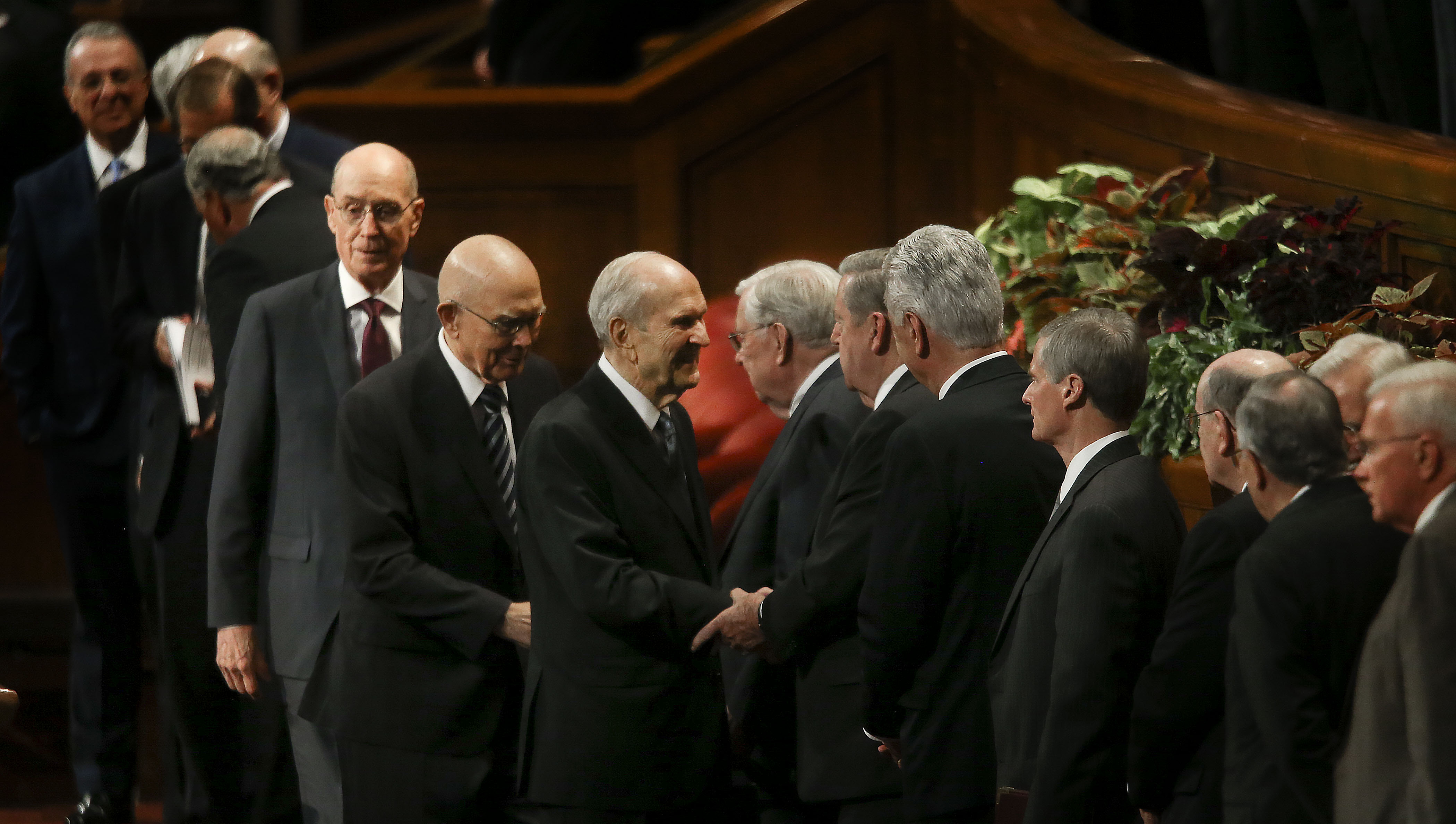 President Russell M. Nelson, center, shakes hands with general authorities after the Sunday afternoon session of the 189th Semiannual General Conference of The Church of Jesus Christ of Latter-day Saints in Salt Lake City on Sunday, Oct. 6, 2019. Following President Nelson is President Dallin H. Oaks, first counselor in the First Presidency, and President Henry B. Eyring, second counselor in the First Presidency.