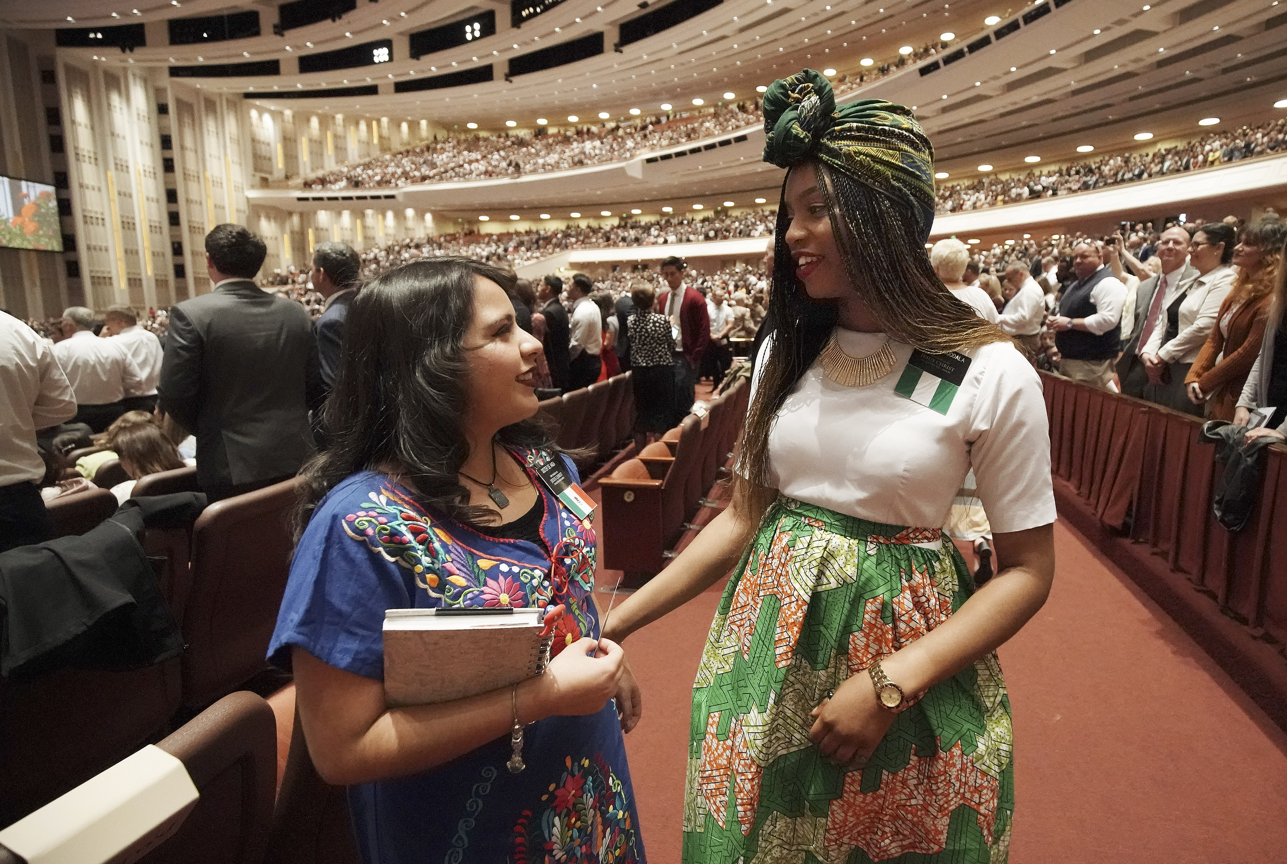 Sisters Marisol De Anda and Andrea Iguodala attend the Sunday afternoon session of the 189th Semiannual General Conference of The Church of Jesus Christ of Latter-day Saints in Salt Lake City on Oct. 6, 2019.