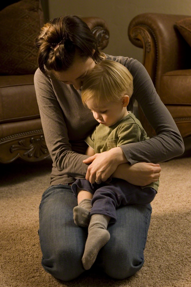 A mother teaches her young son to pray. Parents must teach their children to feel, recognize and know the influence of the Holy Ghost, the Primary general presidency teaches.