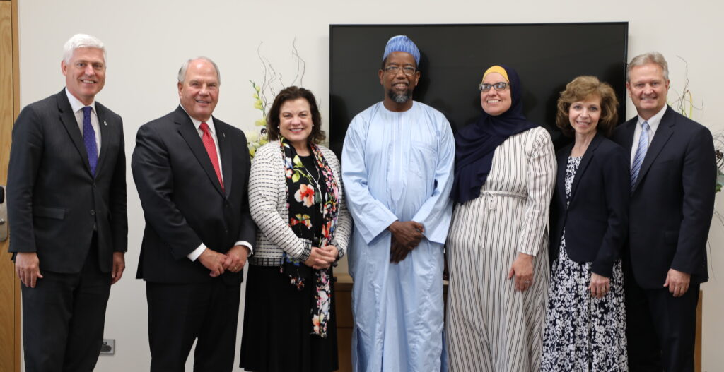Elder Ronald A. Rasband and Sister Melanie Rasband;, second and third from left, meet with Tim Macindoe, member of New Zealand's Parliament, left; Dr. Mustafa Farouk, center,president of the Federation of Islamic Associations of New Zealand, and his wife, Bilkisu Farouk; and Sister Shawna Nattress, second from right; and Elder K. Brent Nattress, a General Authority Seventy and Pacific Area presidency counselor. The group met in Hamilton, New Zealand, on Nov. 16, 2019.