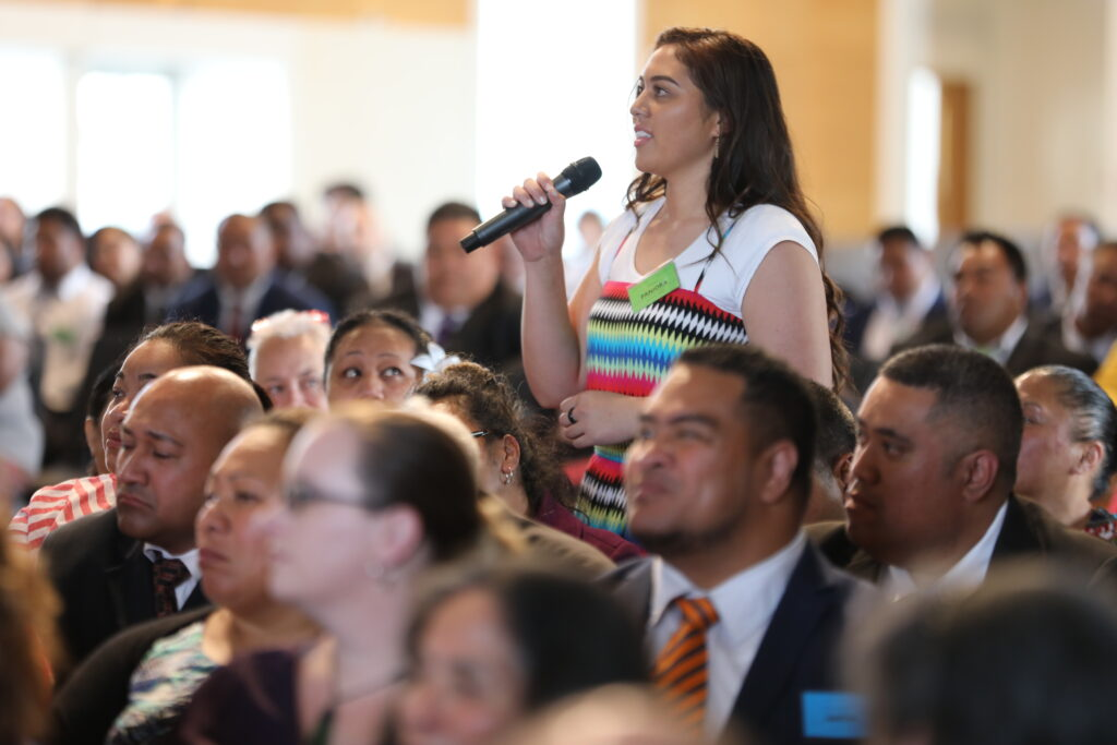 A sister attending the Nov. 16, 2019 Leadership Conference with Elder Ronald A. Rasband in Hamilton, New Zealand, rises to ask a question.