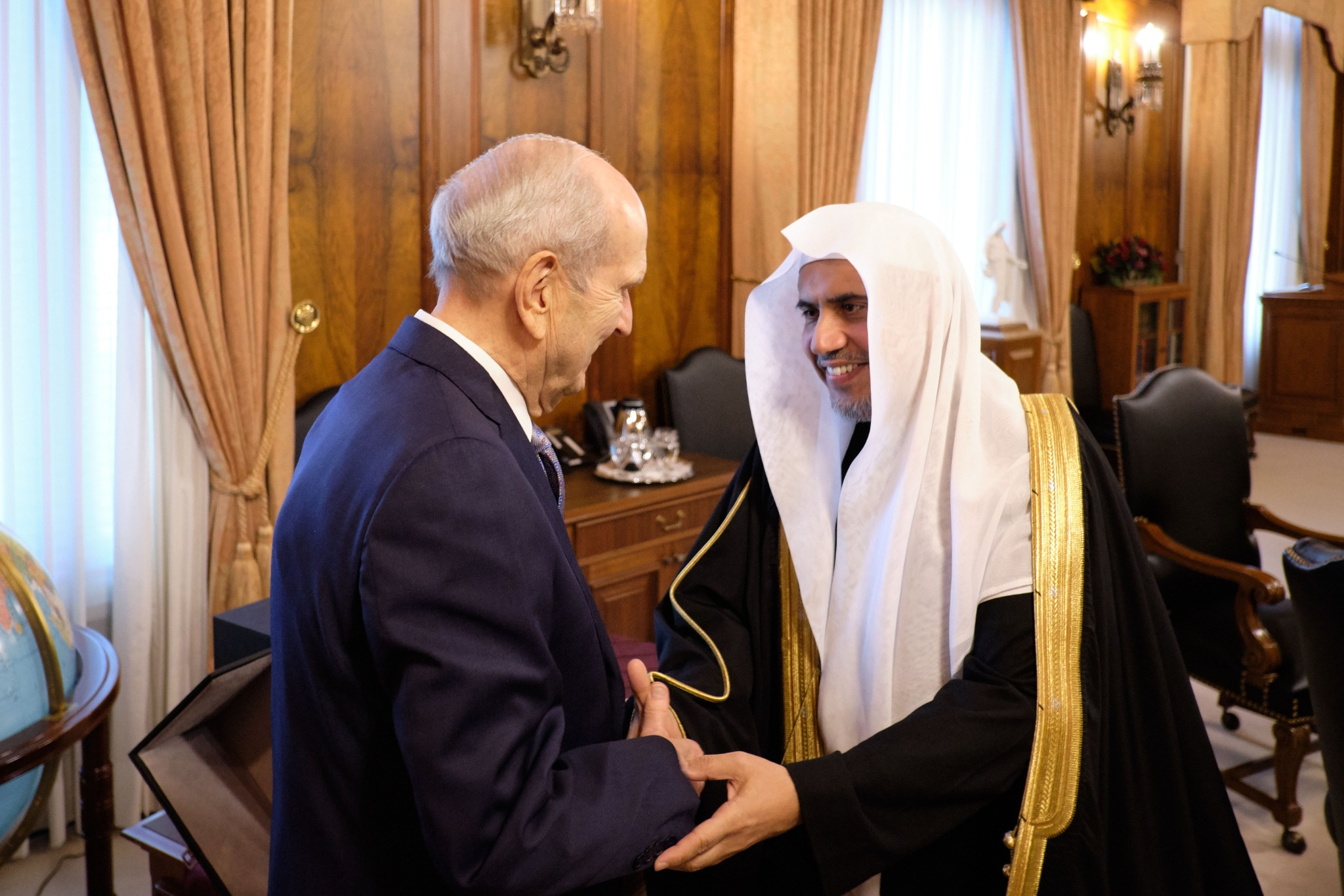 President Russell M. Nelson of The Church of Jesus Christ of Latter-day Saints greets His Excellency Dr. Mohammad Al-Issa, secretary-general of the Muslim World League, on Nov. 5, 2019.