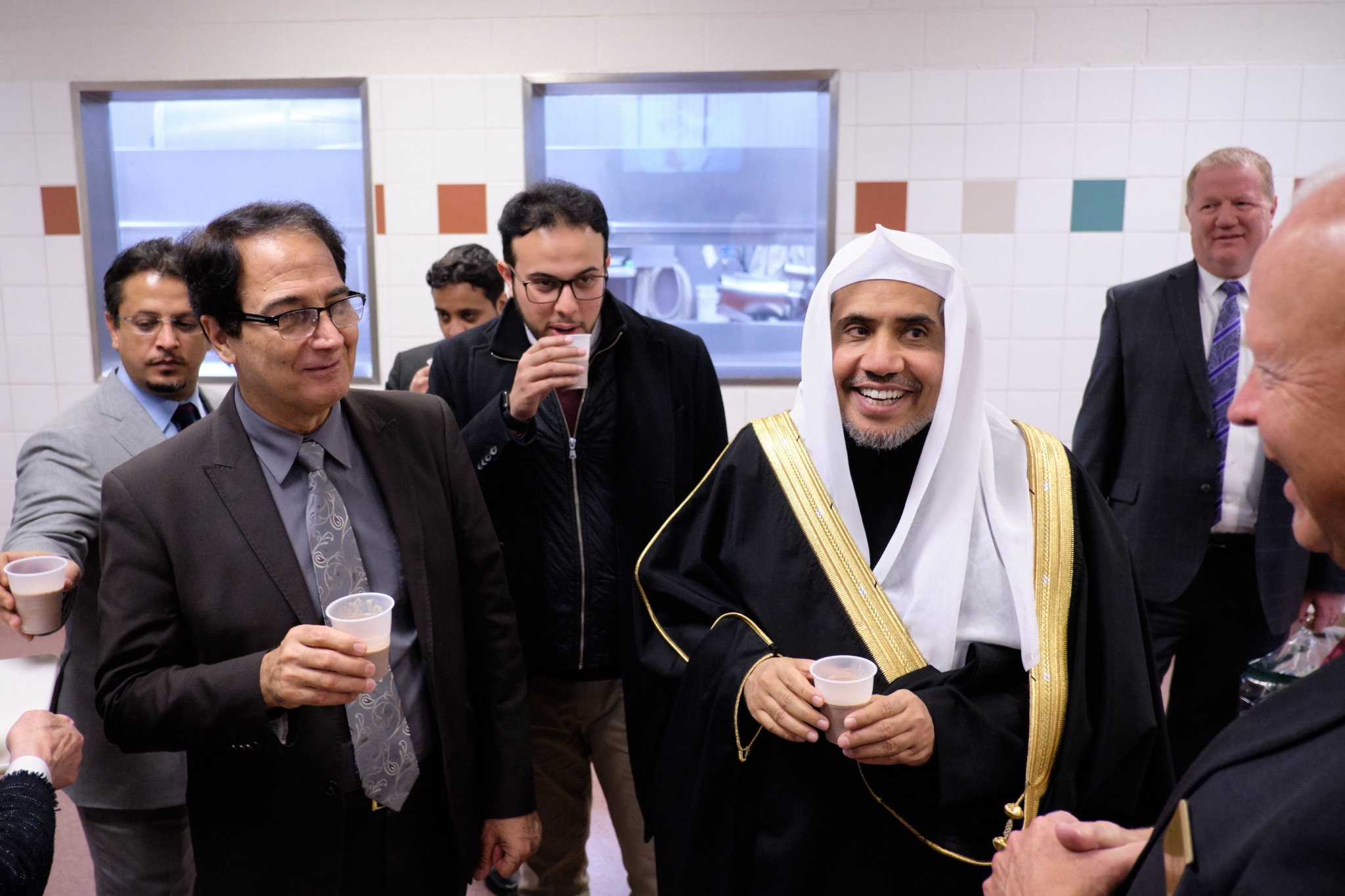His Excellency Dr. Mohammad Al-Issa, secretary-general of the Muslim World League, tastes chocolate milk made on Welfare Square during a visit there on Nov. 5, 2019.