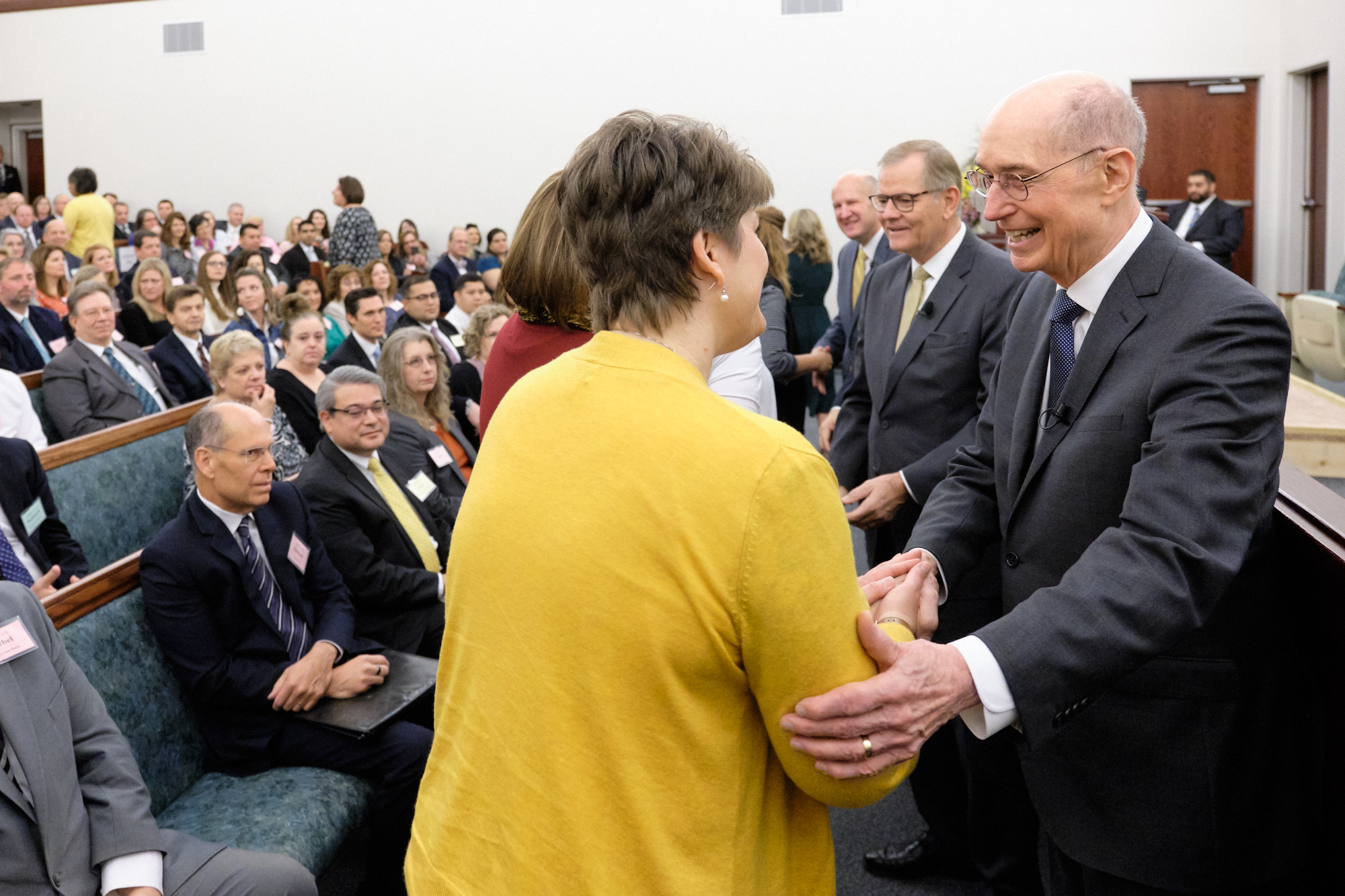 President Henry B. Eyring and Elder Gary E. Stevenson greet local leaders to the Nov. 16, 2019. North Carolina Charlotte Leadership Conference.