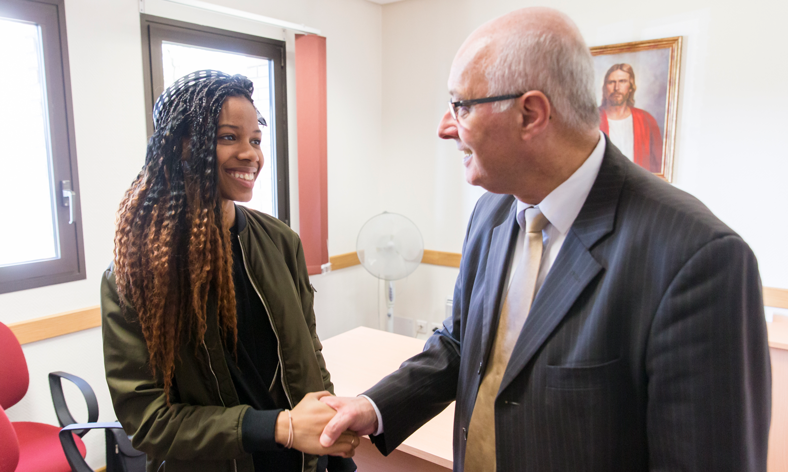 A bishop shakes the hand of a young woman. As President Russell M. Nelson emphasized in the October general conference, the primary responsibility of a bishop is to care for the youth.