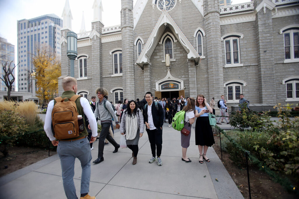 Students leave after listening to Elder Neil L. Andersen speak at an LDS Business College devotional at the Assembly Hall on Temple Square on Tuesday, Nov. 19, 2019.