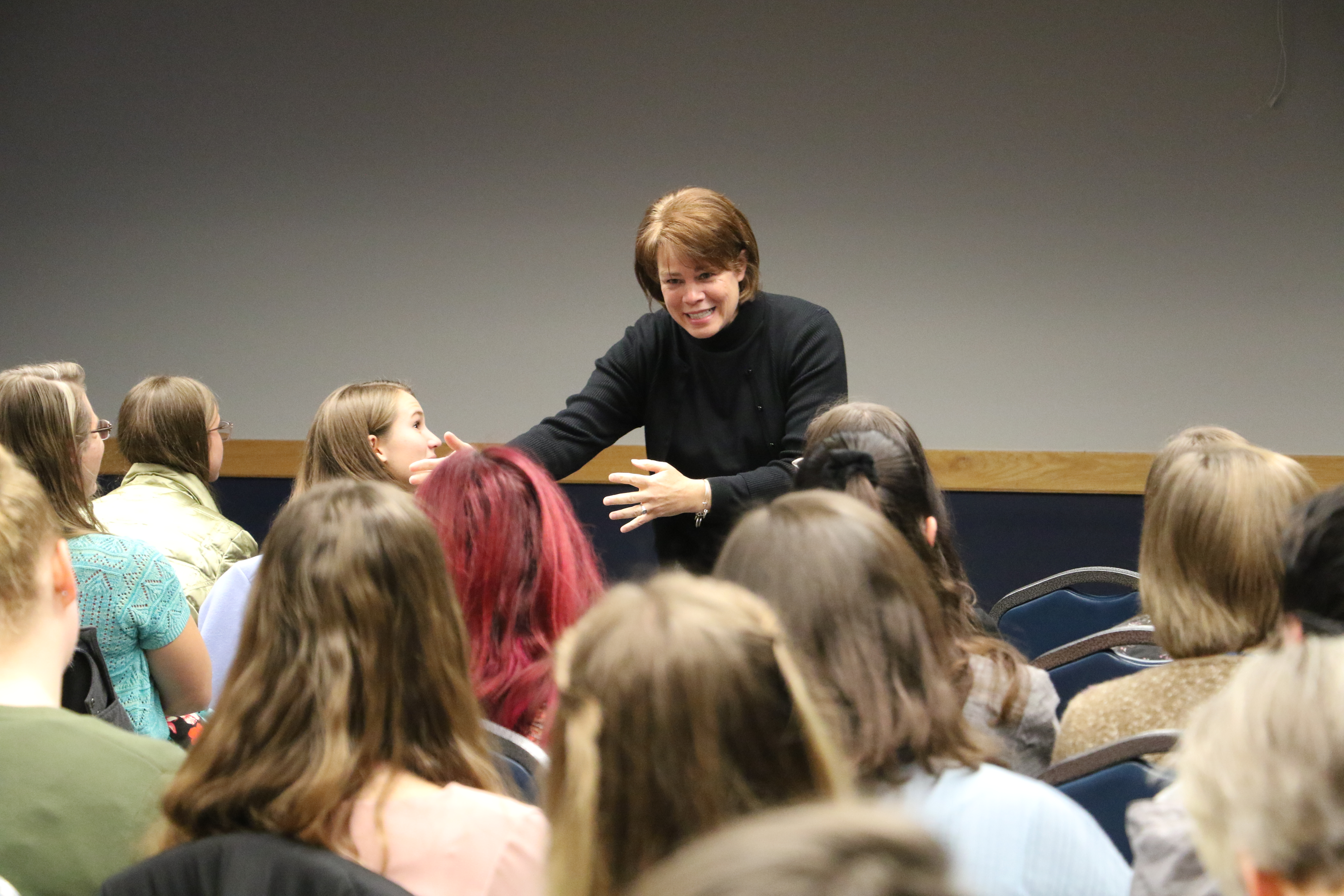 Sister Sharon Eubank speaks to a group of women representing nine stakes in young single adult and young married wards in the Logan, Utah, area prior to a devotional at the Dee Glen Smith Spectrum at Utah State University on Sunday, Nov. 3, 2019.