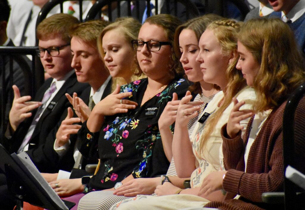 American Sign Language missionaries participate with the Provo Missionary Training Center choir during a Nov. 28, 2019, Thanksgiving Day devotional with Elder Neil L. Andersen in Provo, Utah.