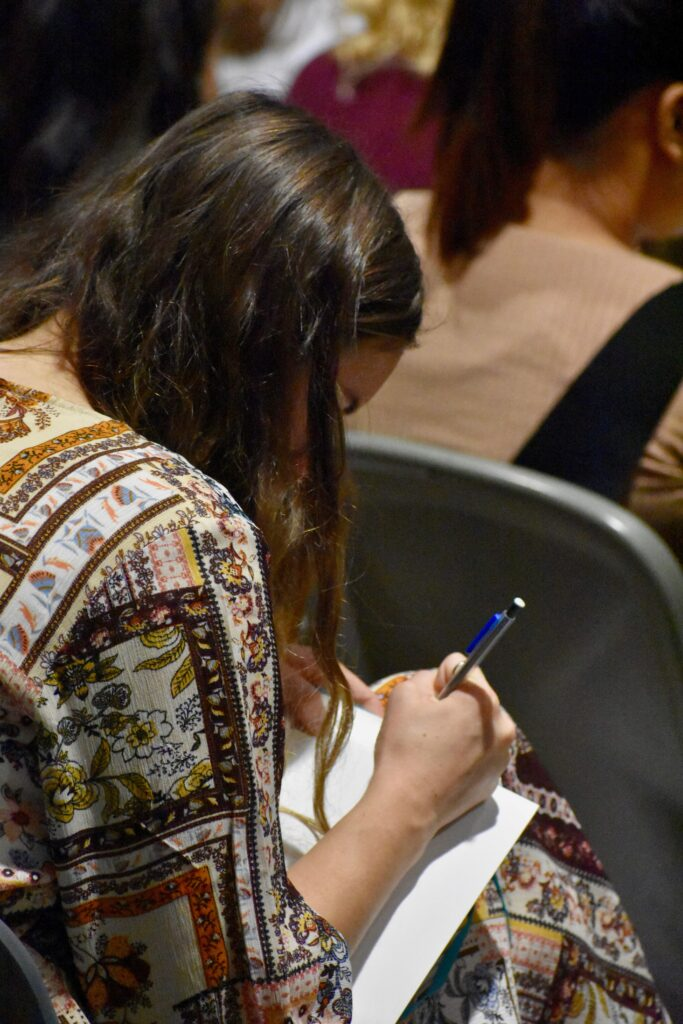 A missionary takes notes during a Nov. 28, 2019, devotional with Elder Neil L. Andersen at the Provo Missionary Training Center in Provo, Utah.
