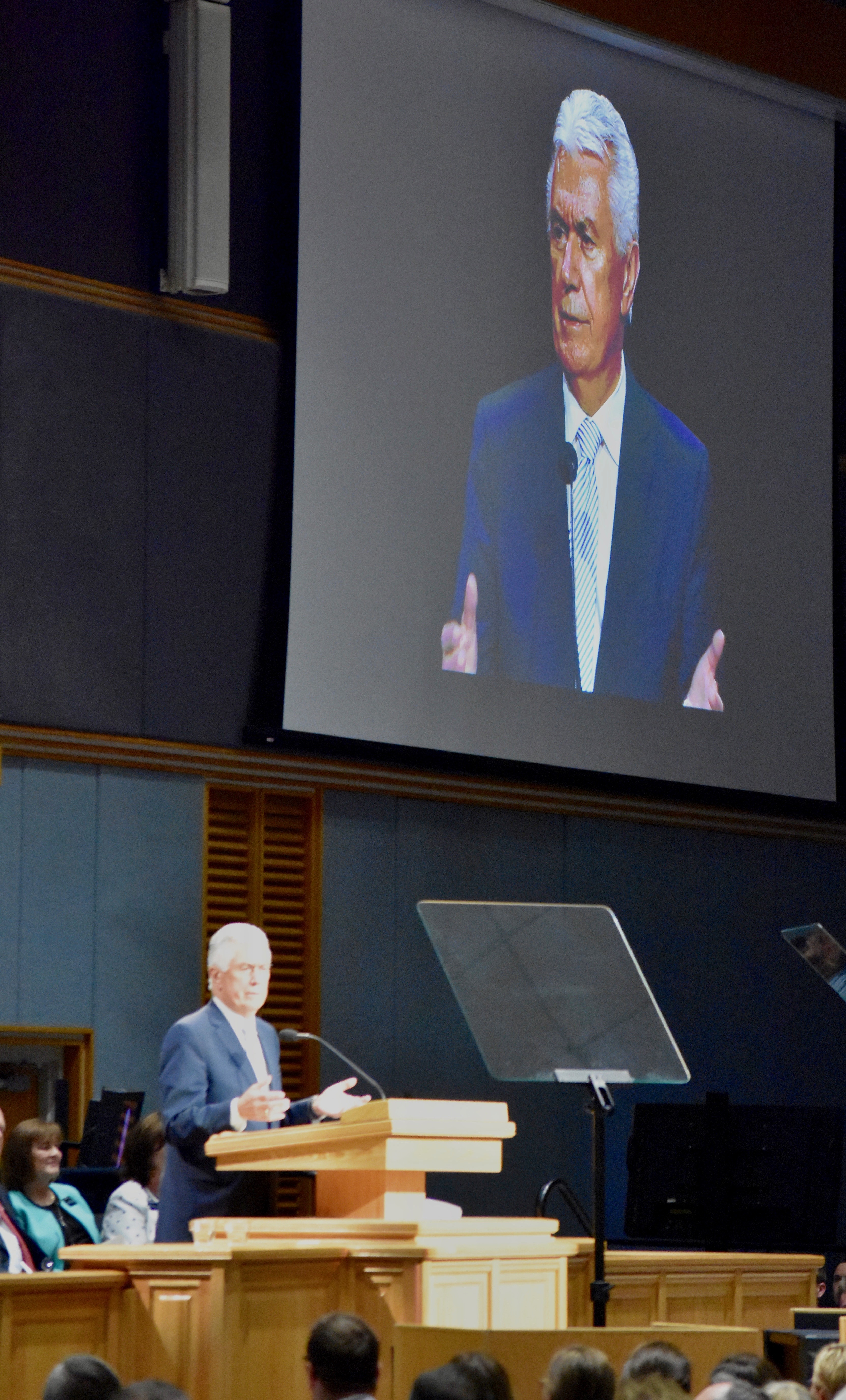 An image of Elder Dieter M. Uchtdorf is projected on the video screen as he speaks at a Provo Missionary Training Center devotional on Nov. 5, 2019.