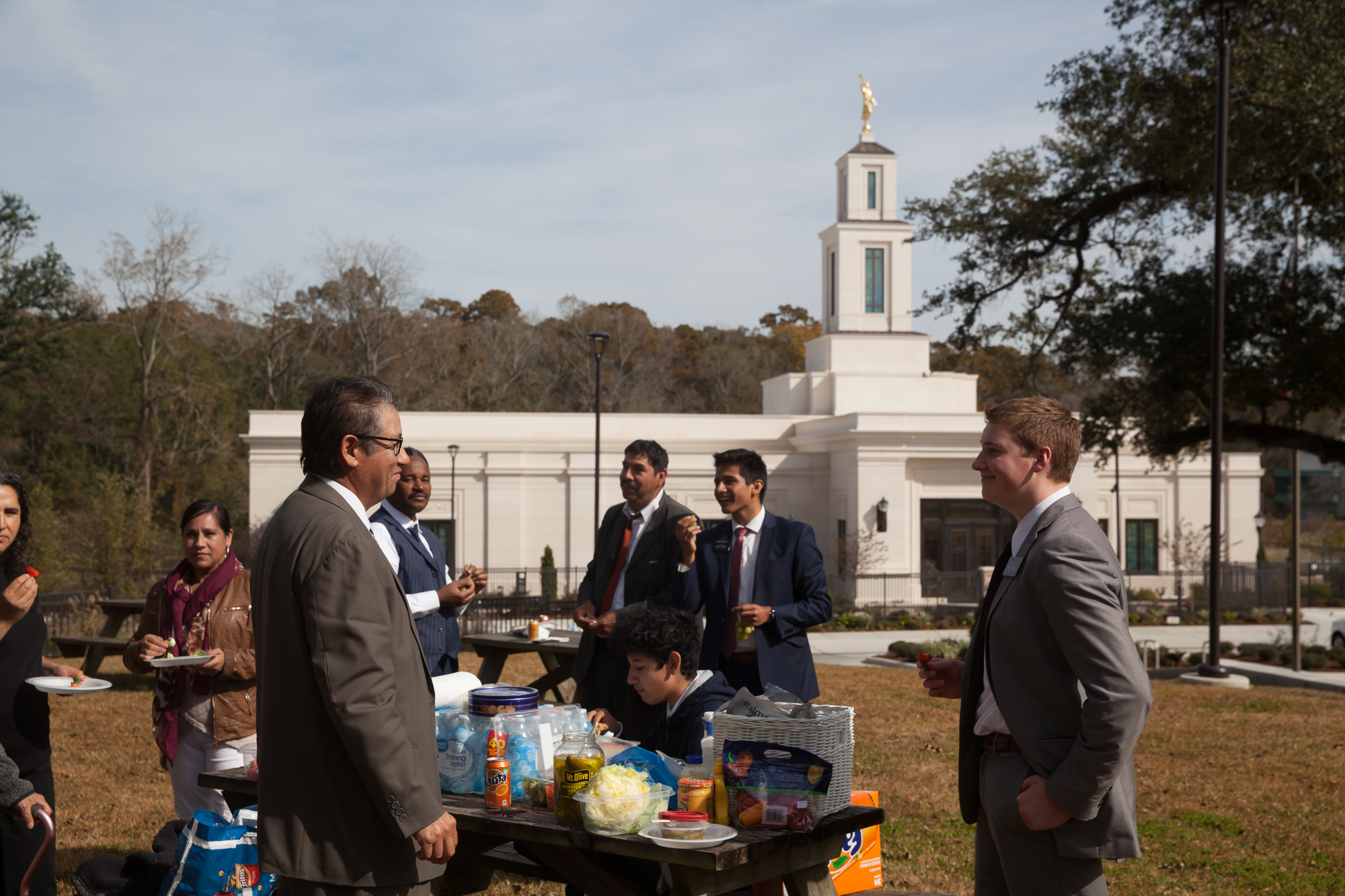 A Latter-day Saint family gathers for a picnic on the grass near the Baton Rouge Louisiana Temple following its rededication on Sunday, Nov. 17, 2019.