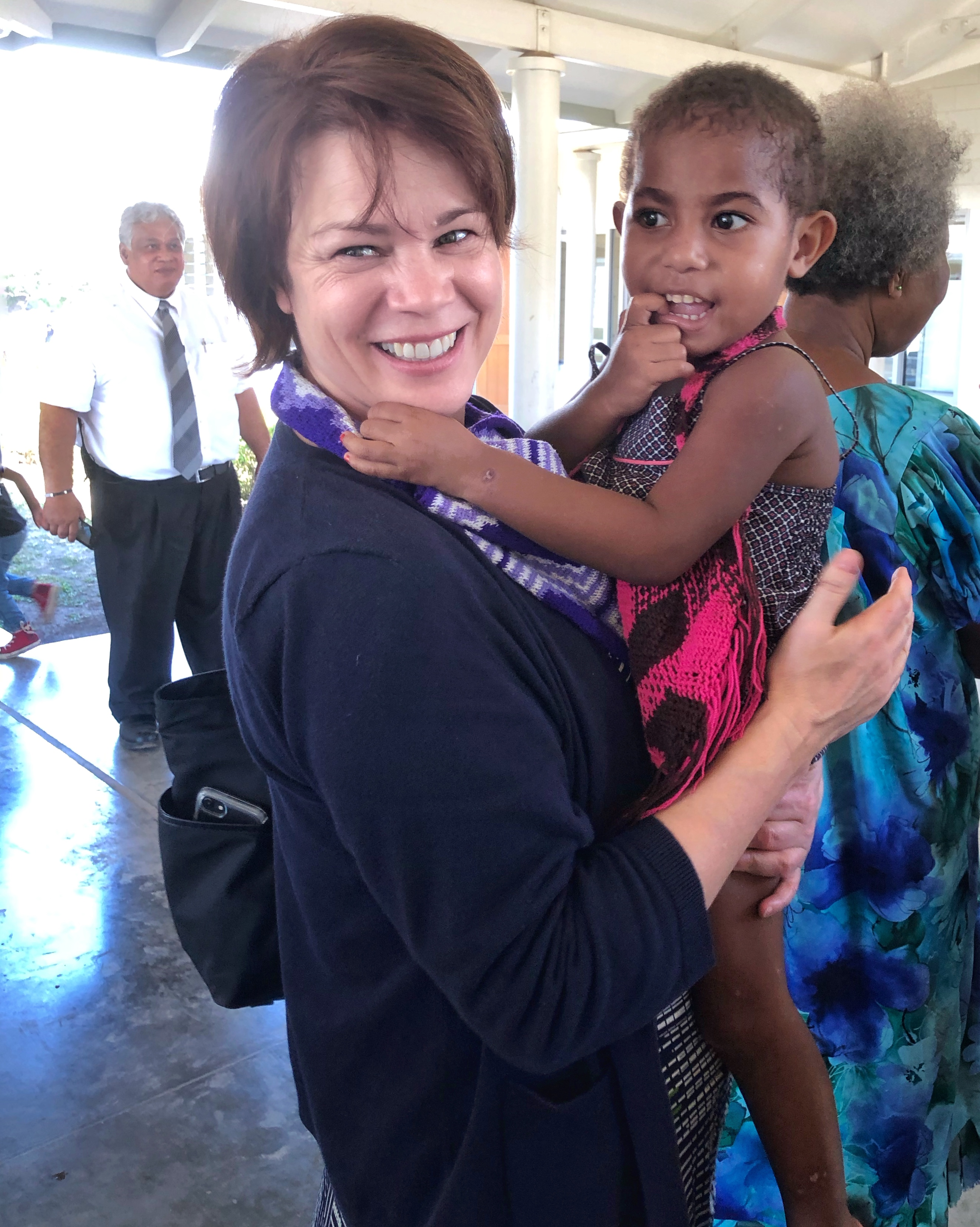 Sister Sharon Eubank holds a child while meeting with members from the Port Moresby Papua New Guinea Stake and the Gerehu and Rigo districts in Papua New Guinea during a visit to the Pacific Area in October 2019.
