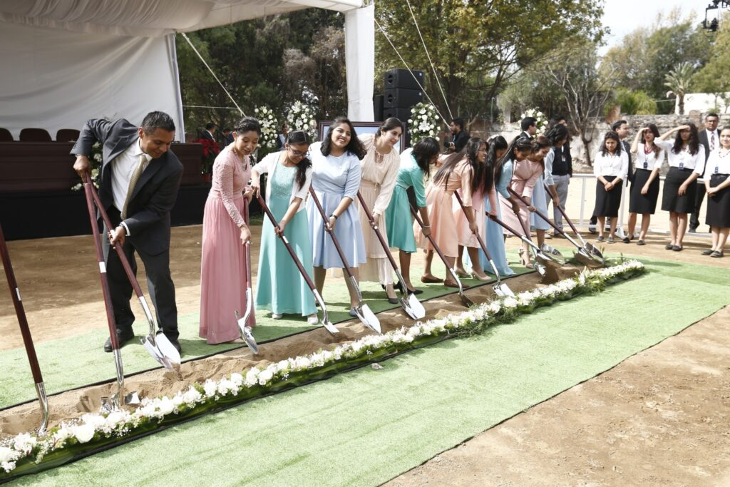 Young women of The Church of Jesus Christ of Latter-day Saints use shovels to lift dirt at the groundbreaking of the Puebla Mexico Temple on Saturday, Nov. 30, 2019.