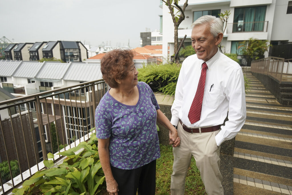 Brother AC Ho holds hands with his wife, Helen Ho, at their home in Singapore on Nov. 20, 2019.