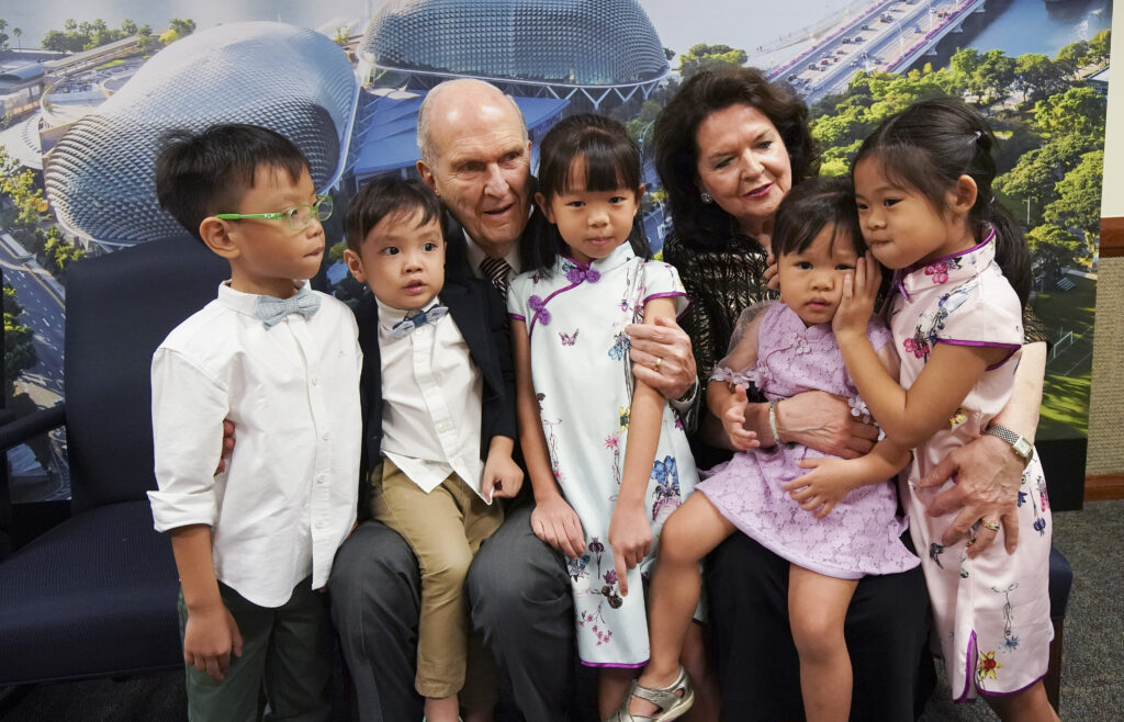 President Russell M. Nelson of The Church of Jesus Christ of Latter-day Saints and his wife, Sister Wendy Nelson, talk with children while meeting with a three-generation family in Singapore on Nov. 20, 2019.