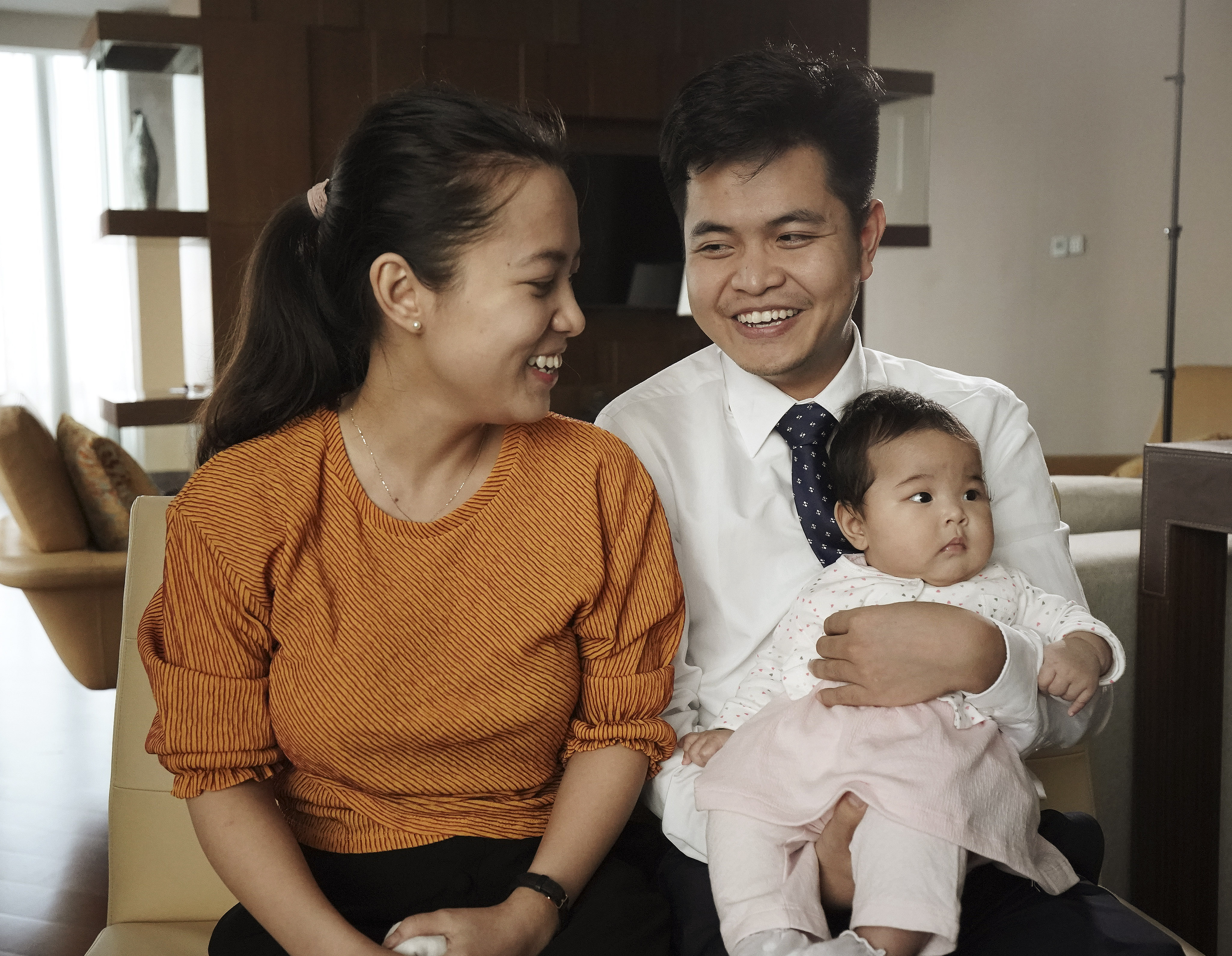Quang Cao, his wife, Nhung Pham and their baby, Han, speak about their conversion in Hanoi, Vietnam, on Sunday, Nov. 17, 2019.