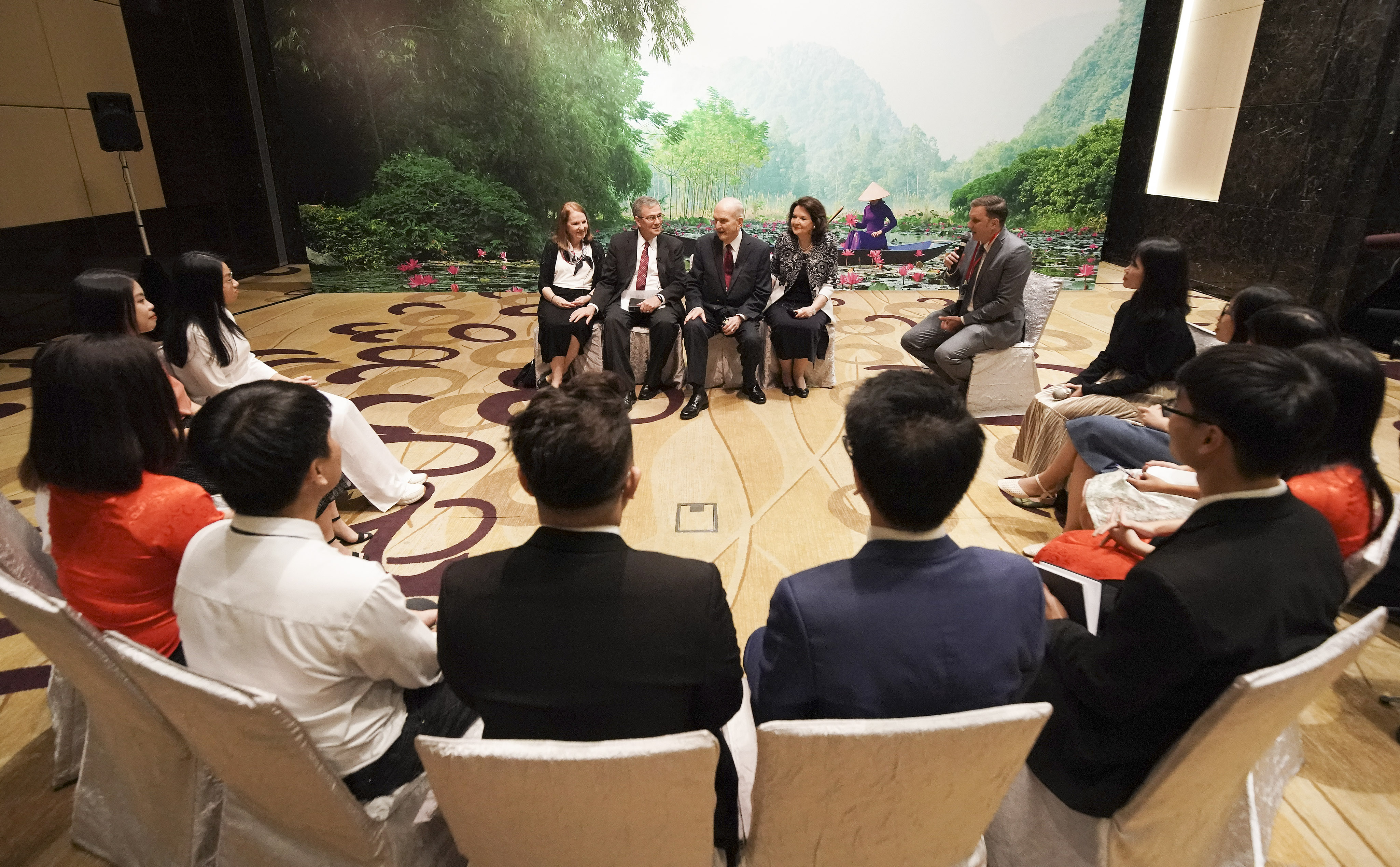 President Russell M. Nelson of The Church of Jesus Christ of Latter-day Saints and his wife, Sister Wendy Nelson, and Elder David F. Evans and his wife, Sister Mary Evans, speak with youth in Hanoi, Vietnam, on Sunday, Nov. 17, 2019.