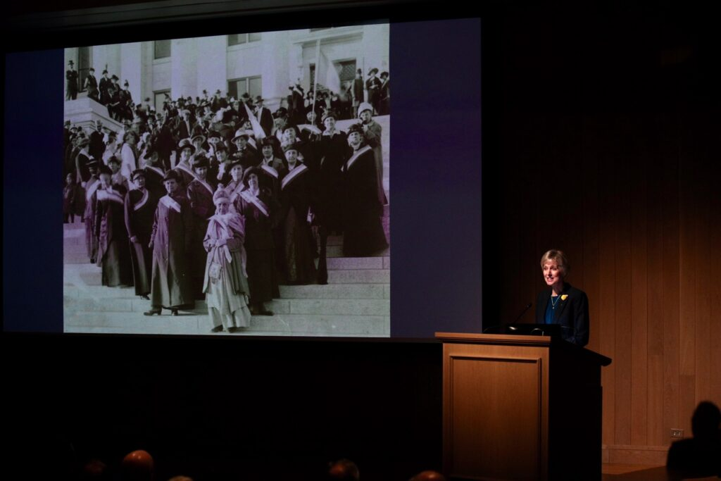 """Sister Jean B. Bingham, Relief Society general president, speaks at the """"Sisters for Suffrage: How Utah Women Won the Vote,"""" exhibit's opening night at the Church History Museum on Nov. 21, 2019, in Salt Lake City, Utah. Sister Bingham spoke of Latter-day Saint women's role in the Utah and national suffragist movement."""