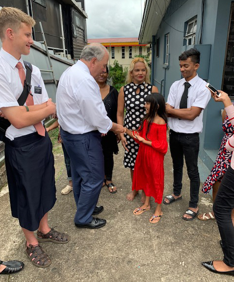 With missionary grandson Elder Ammon MacPherson at his side, Elder Ronald A. Rasband greets Aaliyah R. Chand, who is flanked by her mother Zareena Bi and her recent-convert brother Zaral Ali. Elder Rasban joined his grandson in teaching Aaliyah and Zareena in Suva, Fiji, on Nov. 21, 2019.