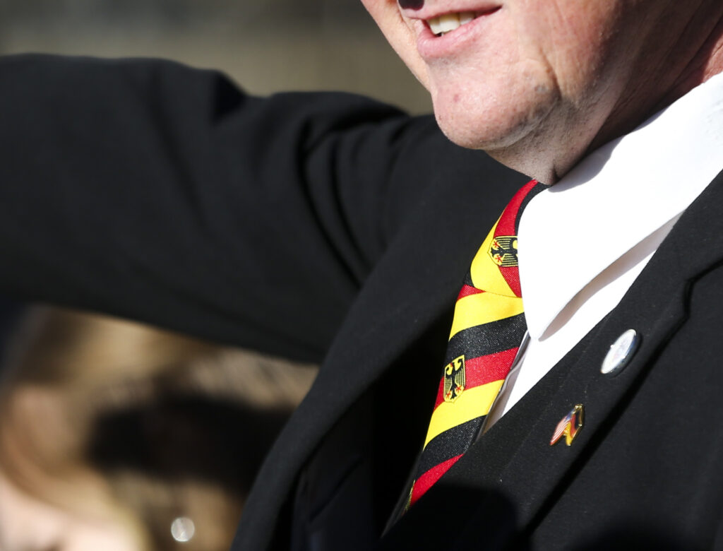 Robert Sellers, of Blackfoot, Idaho, sports a German flag tie during the Volkstrauertag ceremony at the Fort Douglas Military Cemetery in Salt Lake City on Sunday, Nov. 17, 2019. Sellers has been making the trip from Idaho for the ceremony for several decades. Volkstrauertag is the German National Day of Remembrance where the German people honor those that have fall in the line of duty as well as those that were victims of the government. Fort Douglas Military Cemetery is the final resting place of several German prisoners of war that never made it back to Germany.
