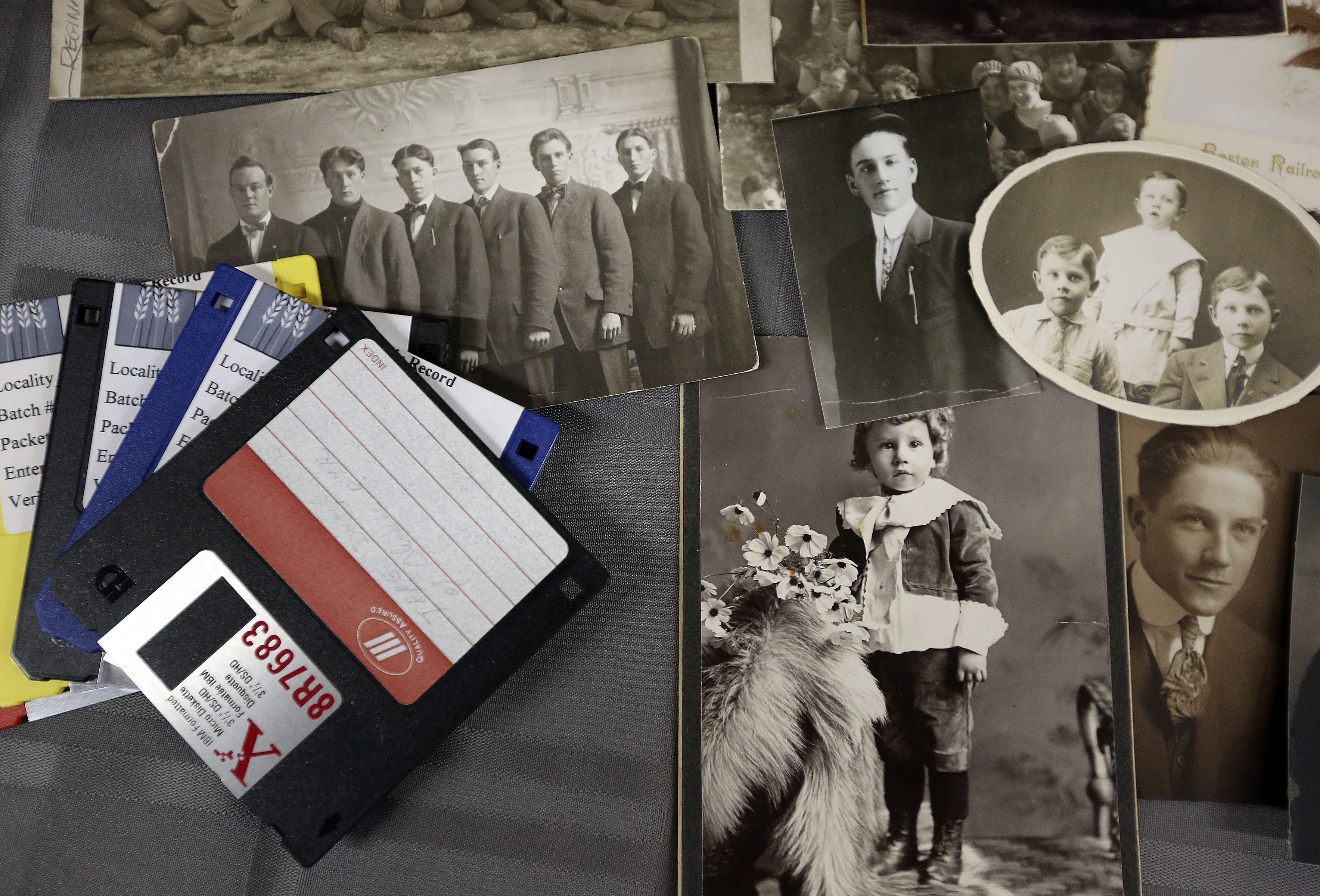 Display of historical photos and hard disks during the FamilySearch 125th anniversary celebration at the Family History Library in Salt Lake City on Wednesday, Nov. 13, 2019.