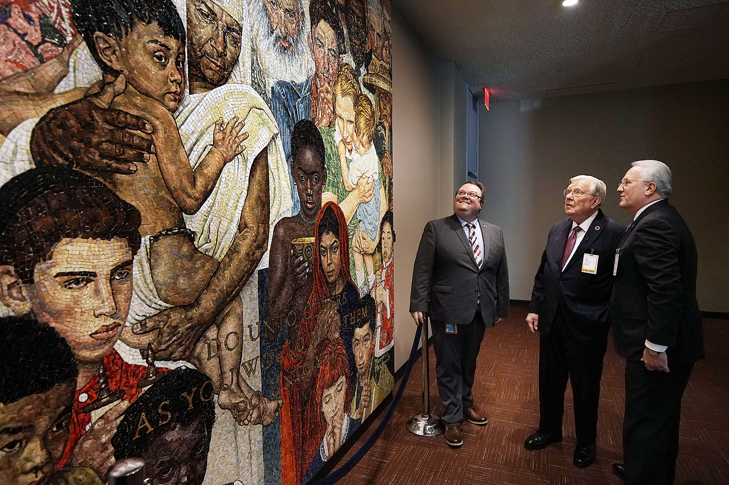 President M. Russell Ballard, second from right, acting president of the Quorum of the Twelve Apostles, and Elder Jack N. Gerard, right, General Authority Seventy, of The Church of Jesus Christ of Latter-day Saints, look at artwork as they tour the United Nations in New York City on Friday, Nov. 15, 2019. Their guide, left, is Felipe Queipo, communications officer for the UN Department of Global Communications.