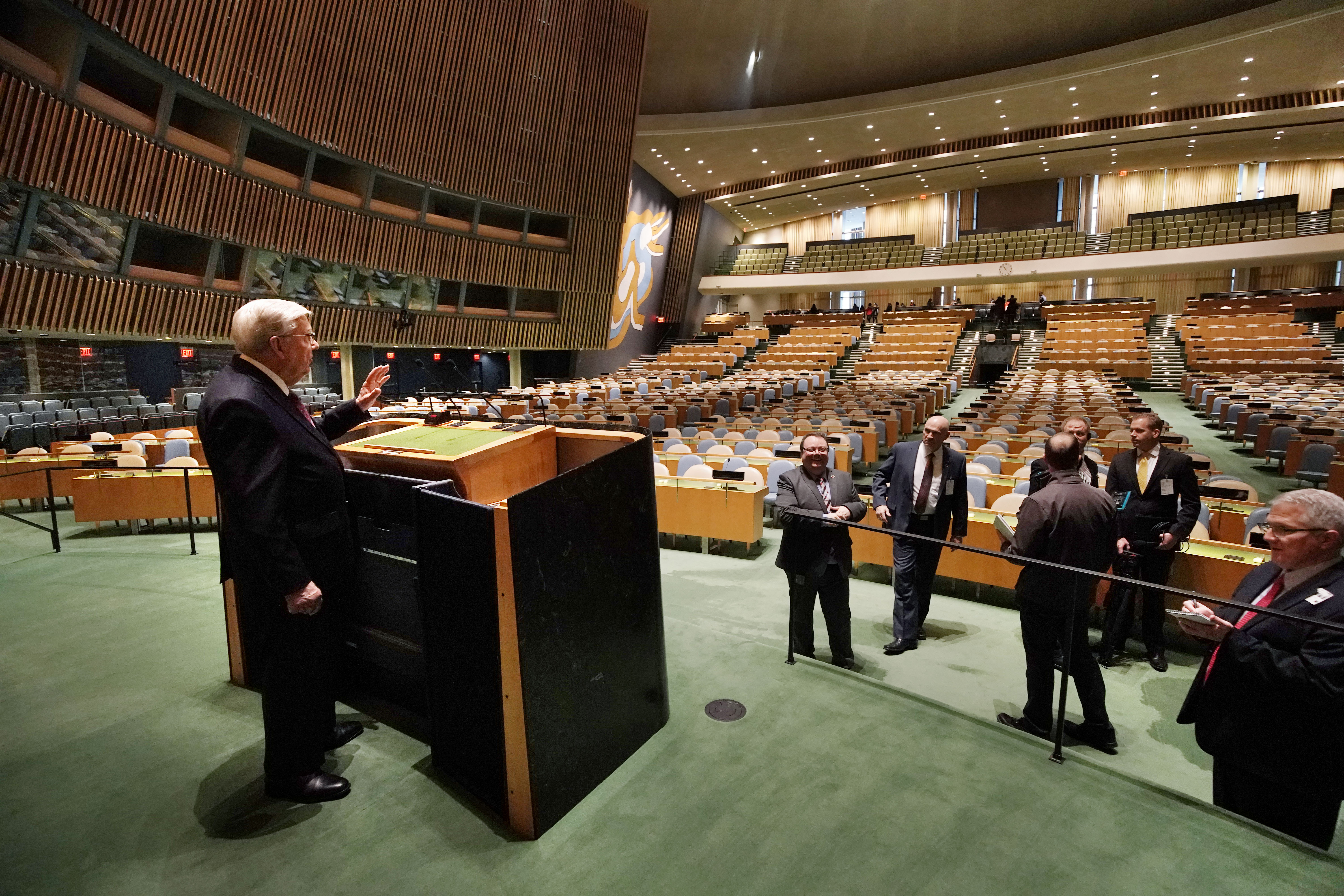 President M. Russell Ballard, acting president of the Quorum of the Twelve Apostles of The Church of Jesus Christ of Latter-day Saints, talks with reporters as he visits the podium of the General Assembly Hall of the United Nations in New York City on Friday, Nov. 15, 2019.