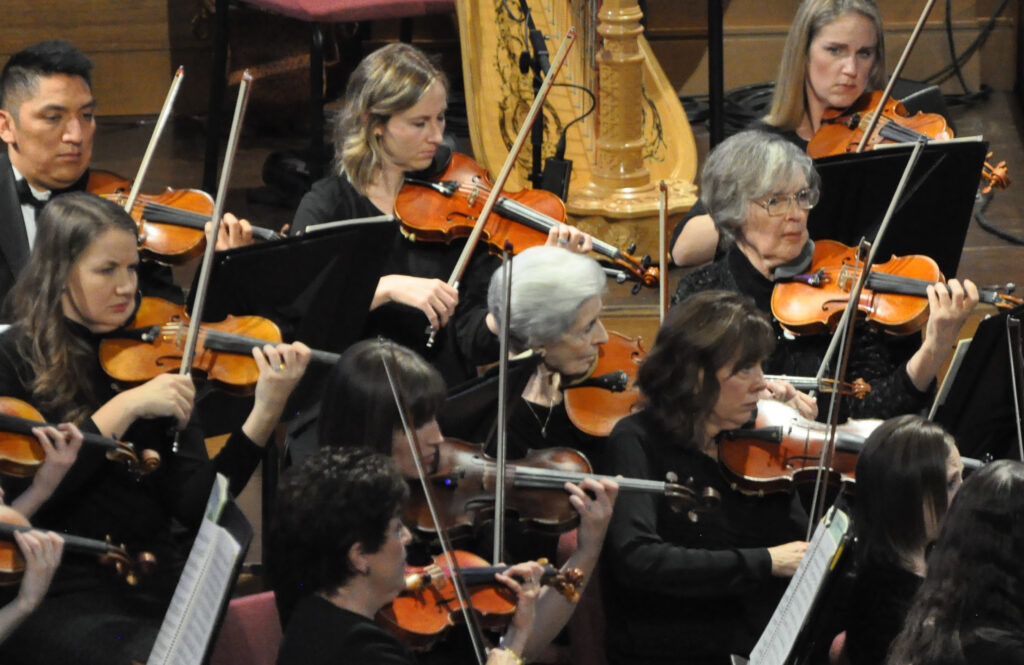 Marilyn Anderson, center, has been a key member of the violin section of the Orchestra at Temple Square since its beginnings 20 years ago. She enjoys utilizing music to share her gospel testimony