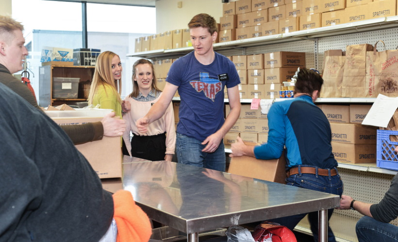 Young missionaries help restock shelves at Northwest Assistance Ministries in Houston, Texas, with donations from the Church Welfare Department on Nov. 13, 2019.