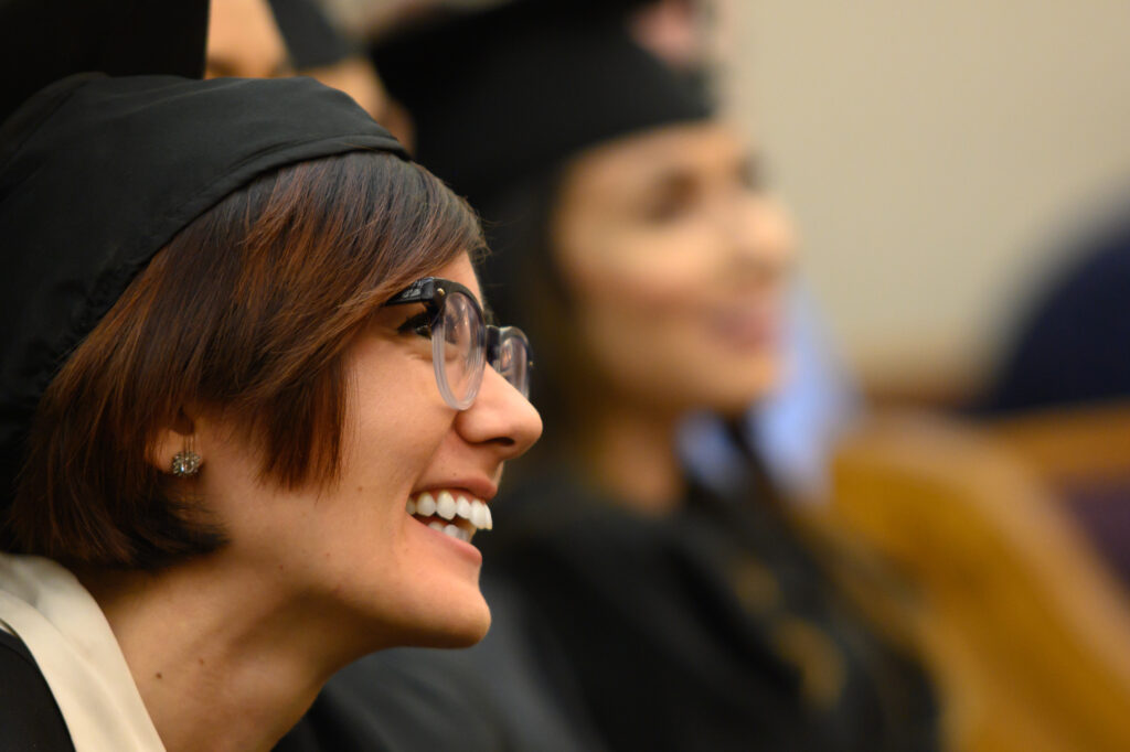 A graduate smiles during the convocation for the College of Education and Human Development: Sociology, Social Work and Psychology on Wednesday, Dec. 18, 2019.