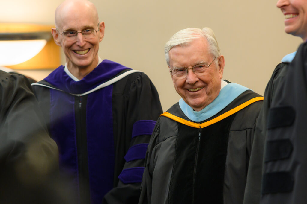 President M. Russell Ballard, right, and President Henry J. Eyring, president of BYU–Idaho, left, smile as they greet graduates following the convocation for the College of Education and Human Development: Sociology, Social Work and Psychology on Wednesday, Dec. 18, 2019.