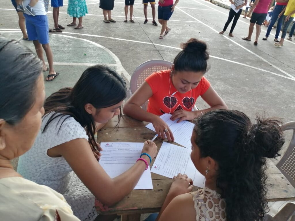 Students gather in the courtyard of one of the schools where Kenneth Grover sponsors scholarships in Guatemala.