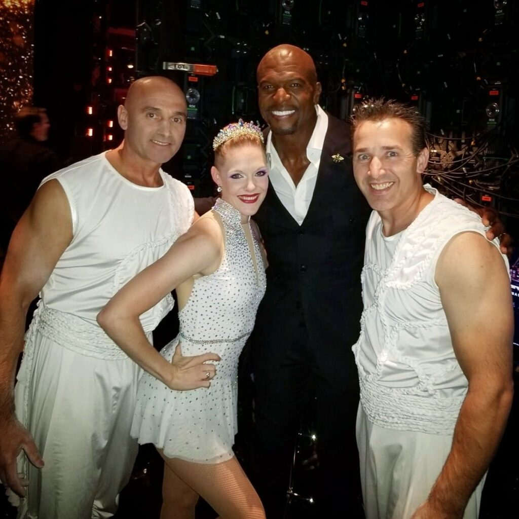 "From left, Sergei Sandou, Cassie Sandou and Konstantin Sandou are pictured with Terry Crews, middle right, at the Dolby Theatre in Los Angeles on Aug. 28, 2019. The Sandou Trio performed for the live results of ""America's Got Talent"" season 14 and will be featured on the second season of ""America's Got Talent: Champions"" airing in January."